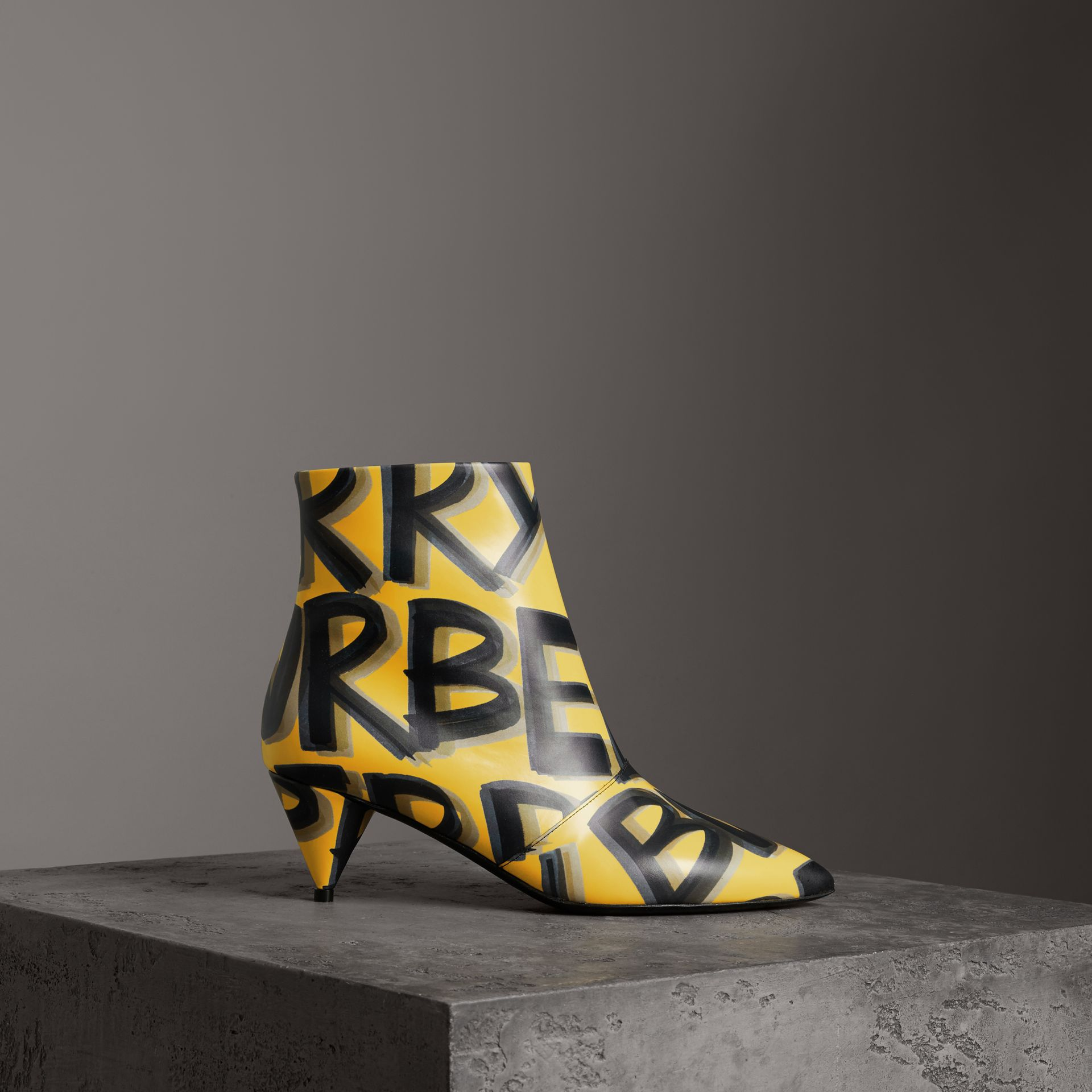 Graffiti Print Leather Ankle Boots in Vibrant Yellow - Women | Burberry Singapore - gallery image 0