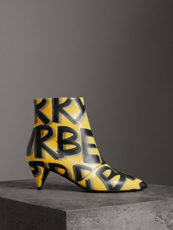 Graffiti Print Leather Ankle Boots in Vibrant Yellow