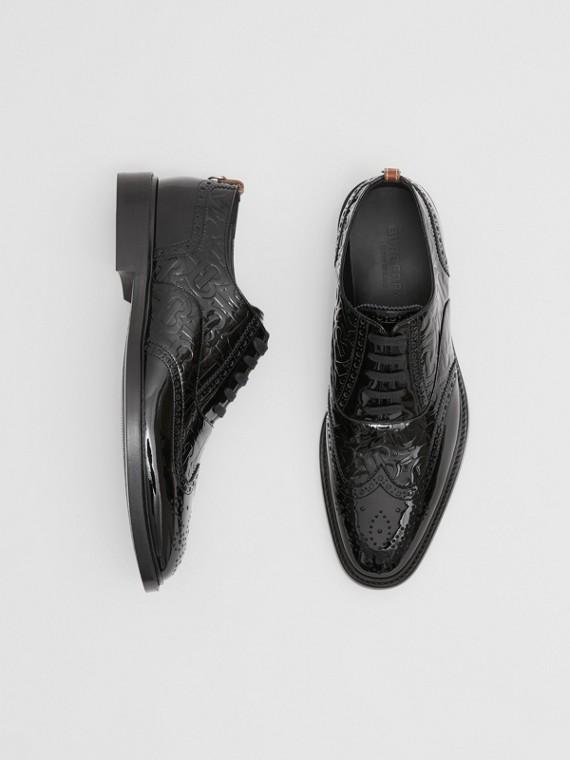 Sapatos brogue de couro envernizado com monograma e argola em D (Preto)