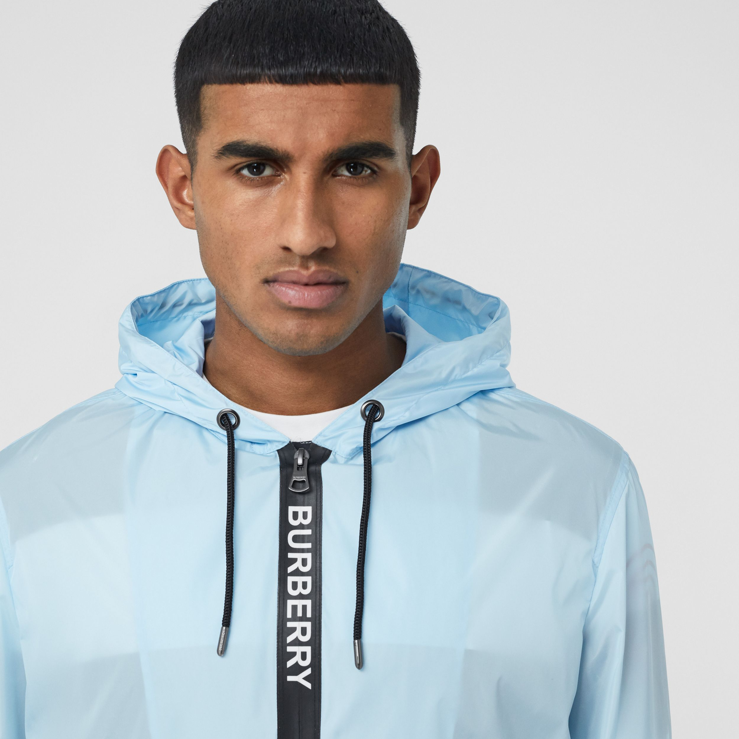 Logo Tape ECONYL® Hooded Jacket in Pale Blue - Men | Burberry - 2
