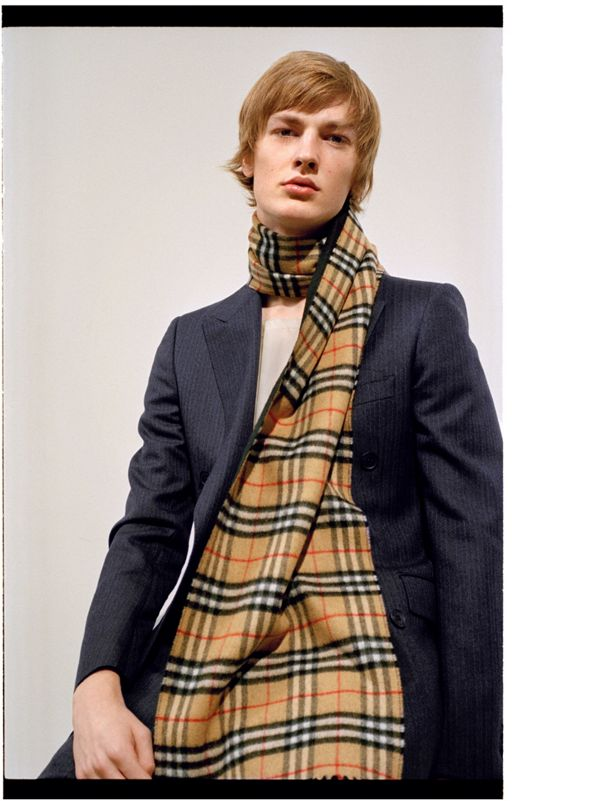 Honza creates scale with a high neck and waterfall of Vintage check.
