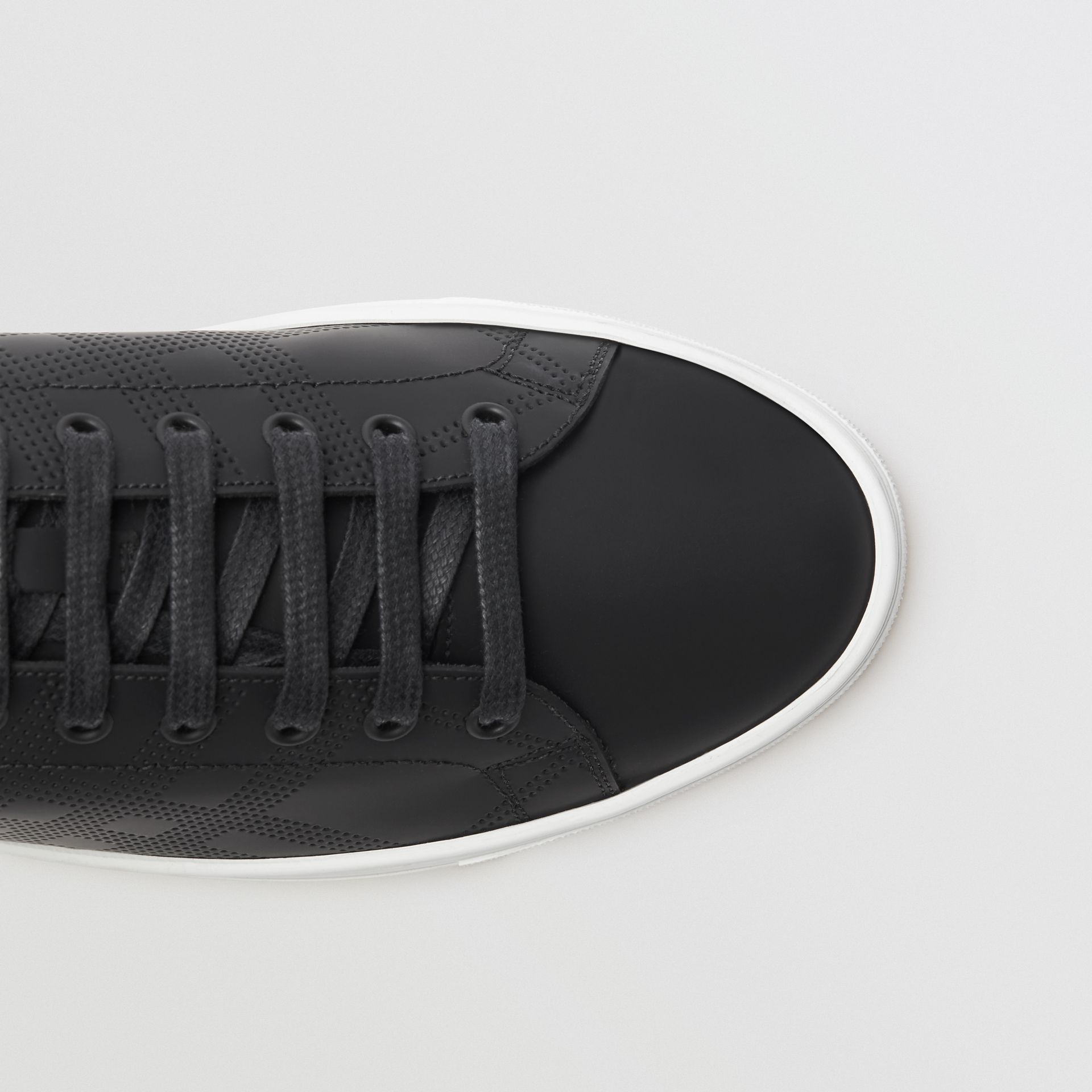 Perforated Check Leather Sneakers in Black - Men | Burberry United States - gallery image 1