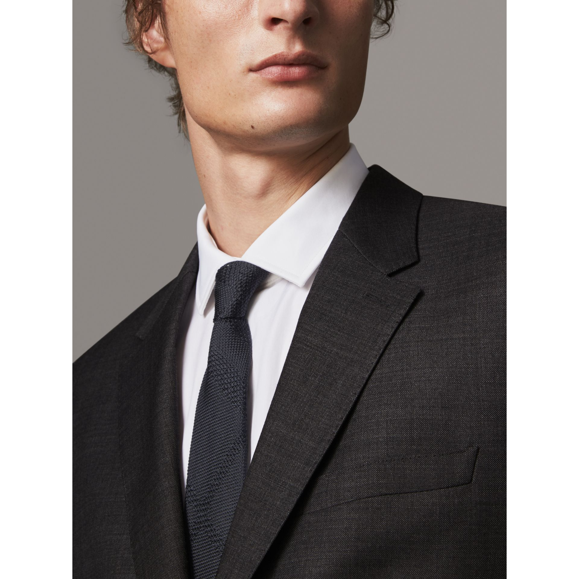 Modern Fit Travel Tailoring Virgin Wool Suit in Dark Grey Melange - Men | Burberry Canada - gallery image 1