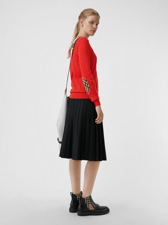 Pull en laine mérinos avec détails à motif Vintage check (Rouge Orangé)