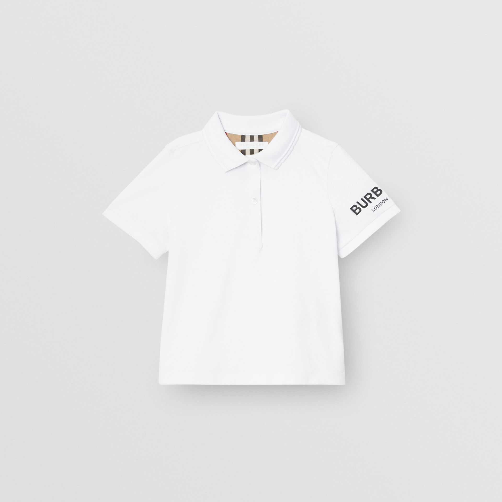 Logo Print Cotton Piqué Polo Shirt in White | Burberry Australia - gallery image 0