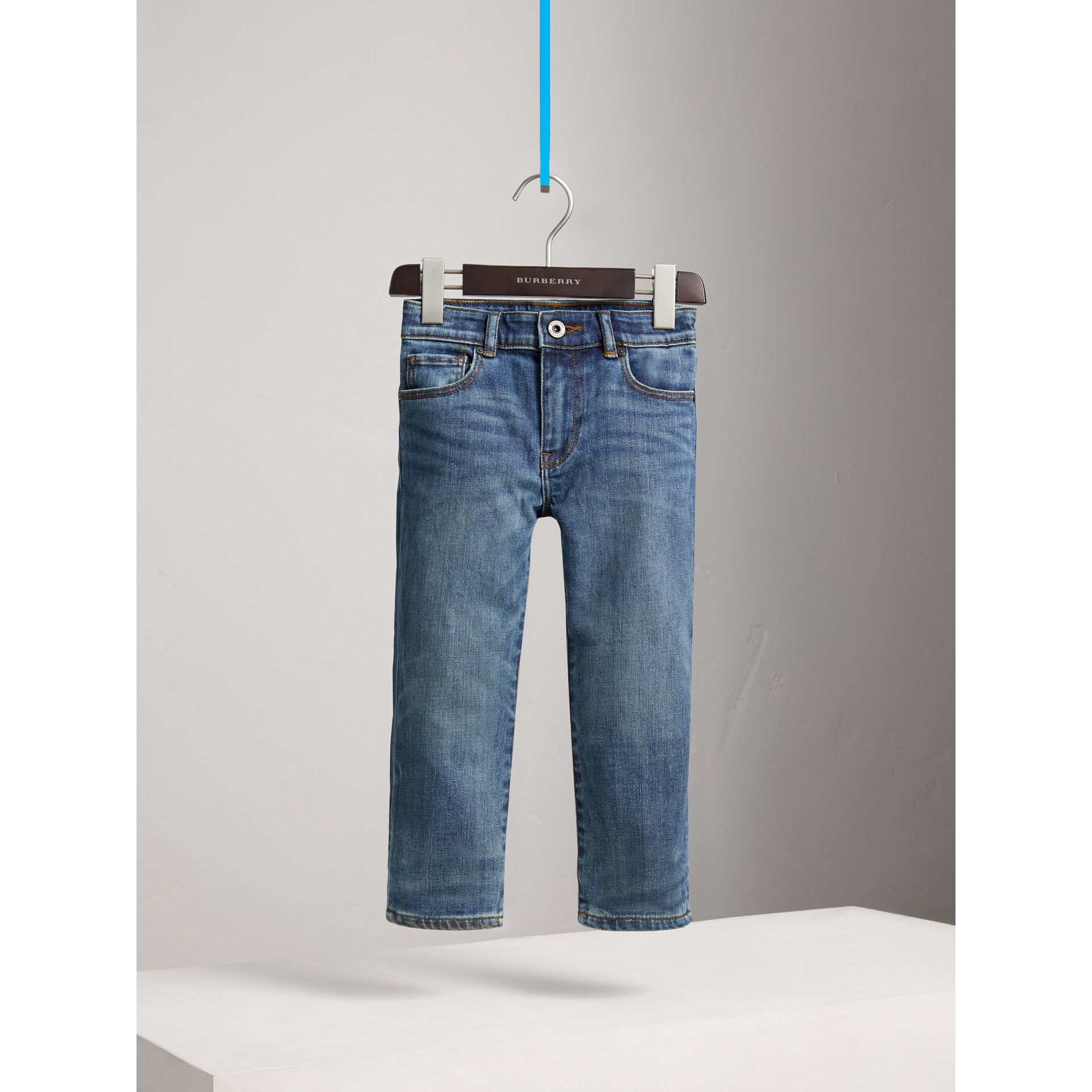 Relaxed Fit Stretch Denim Jeans in Mid Indigo - Boy | Burberry United Kingdom - gallery image 0