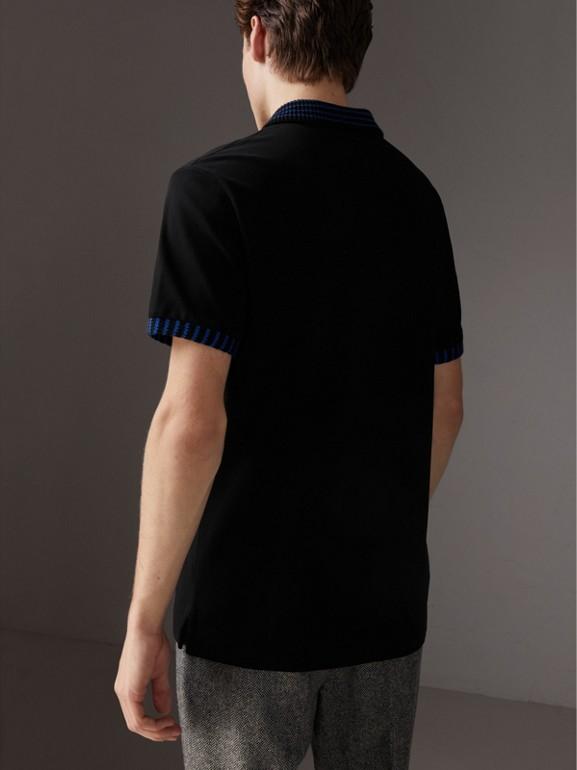 Polo in cotone piqué con dettaglio lavorato a maglia (Nero) - Uomo | Burberry - cell image 1