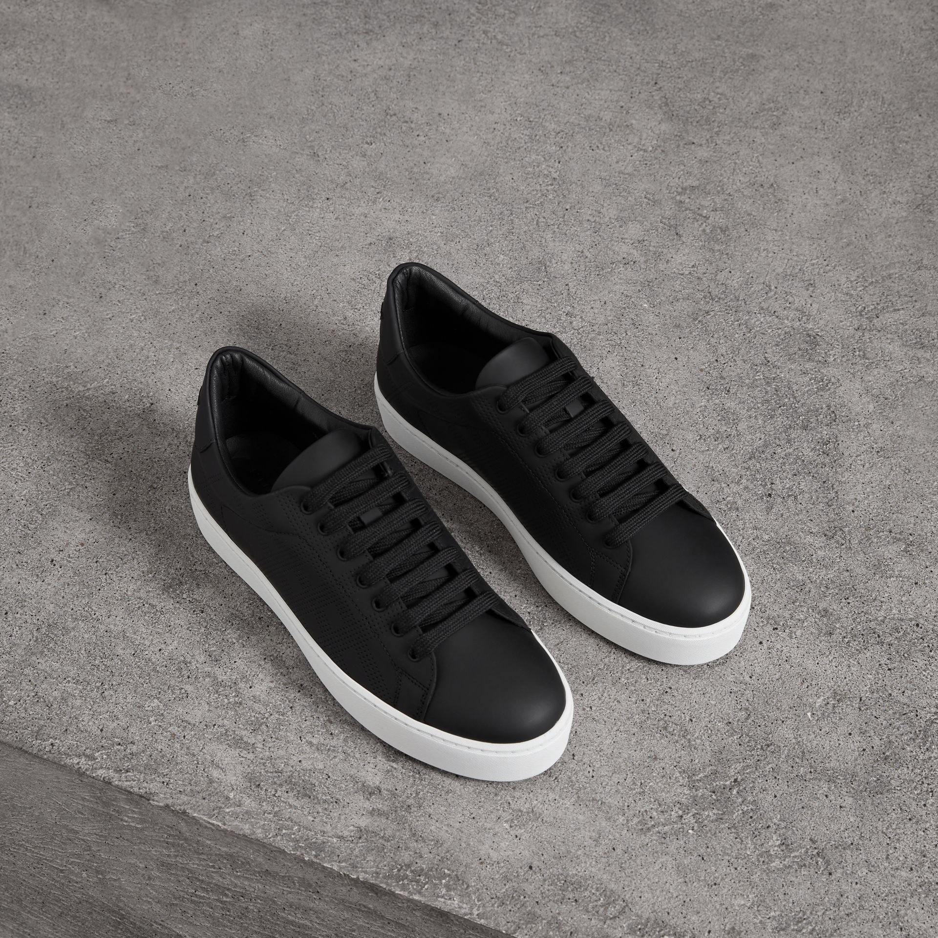 Perforated Check Leather Sneakers in Black - Women | Burberry Singapore - gallery image 0