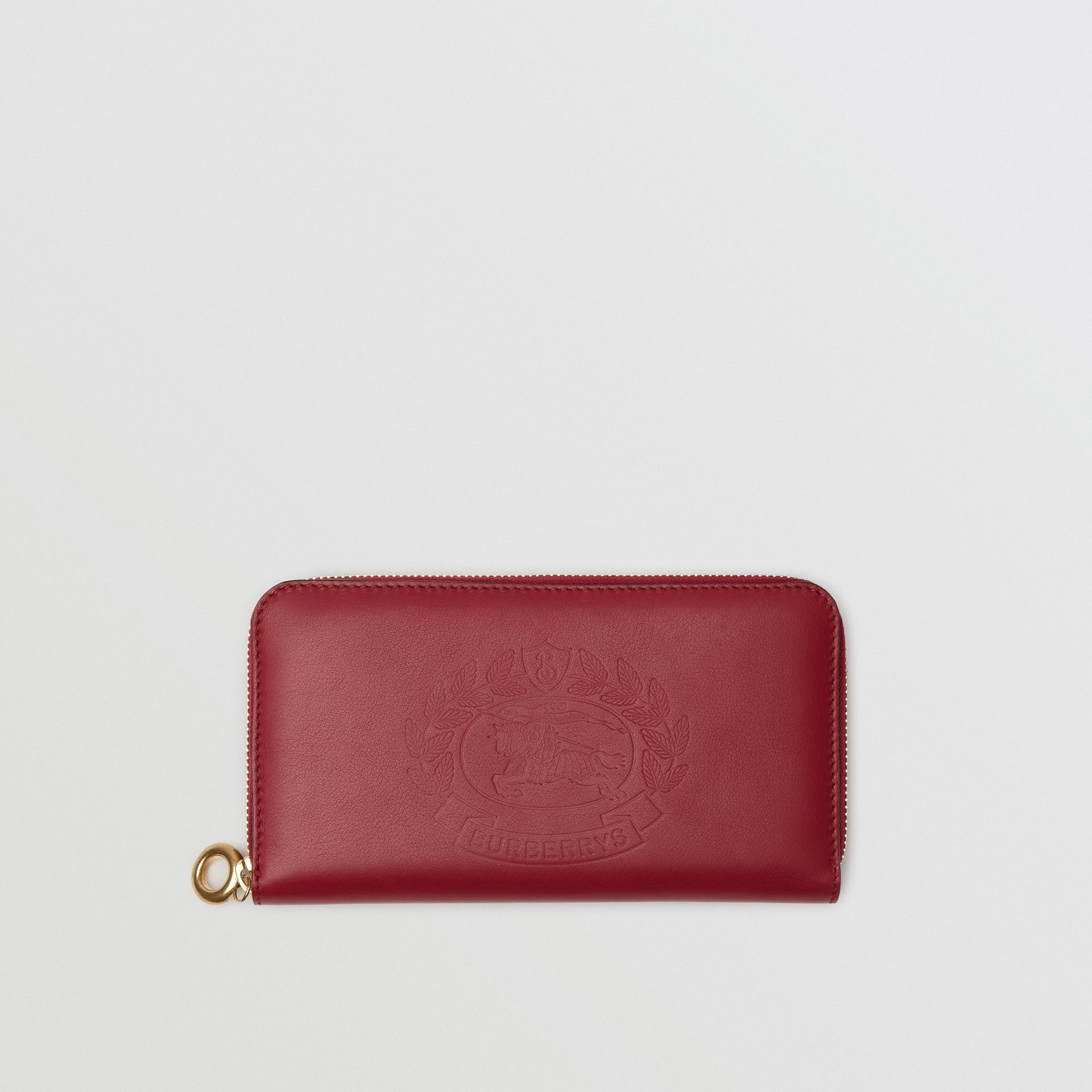 Embossed Crest Two-tone Leather Ziparound Wallet in Crimson - Women | Burberry Hong Kong - gallery image 0