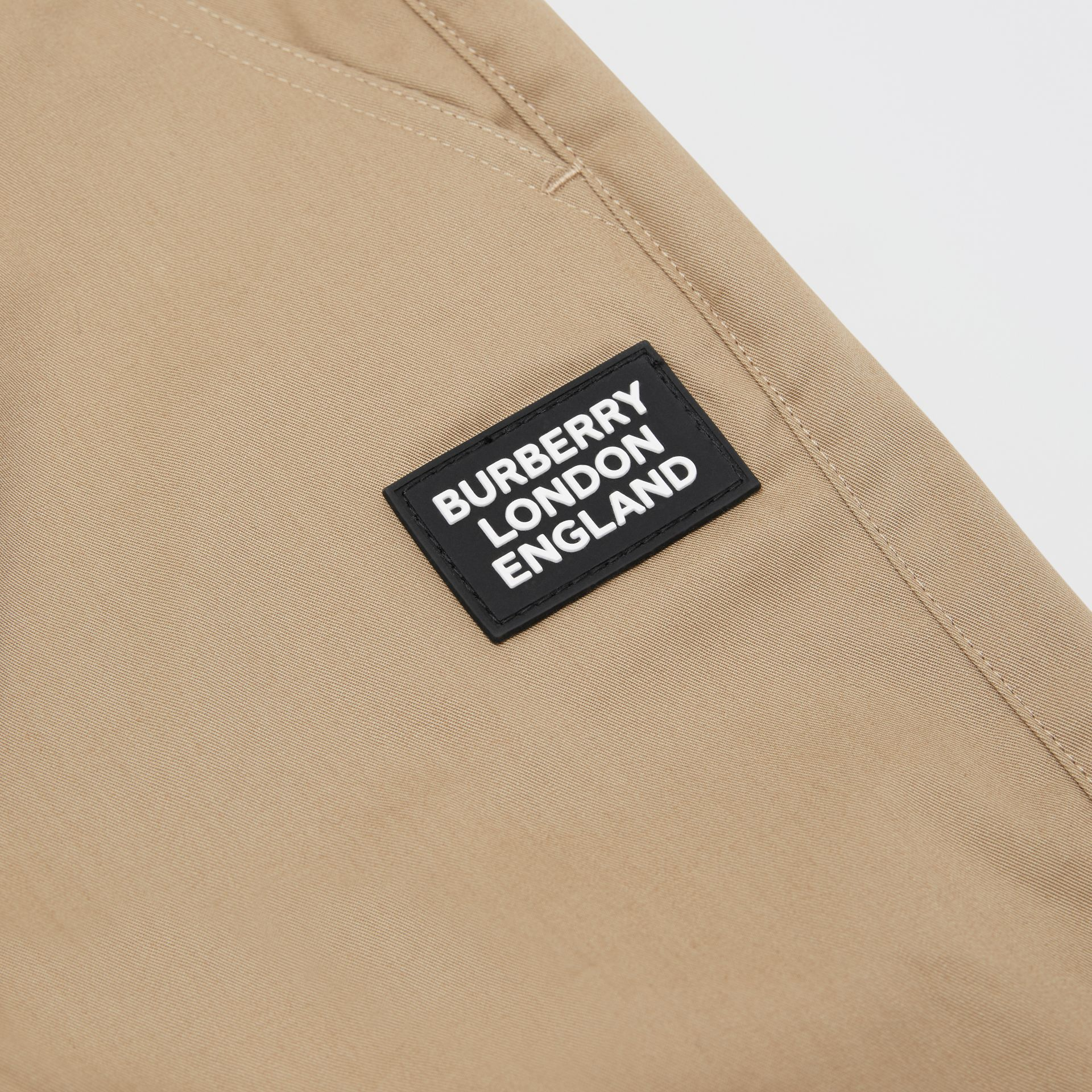 Logo Appliqué Cotton Twill Trackpants in Honey | Burberry - gallery image 1