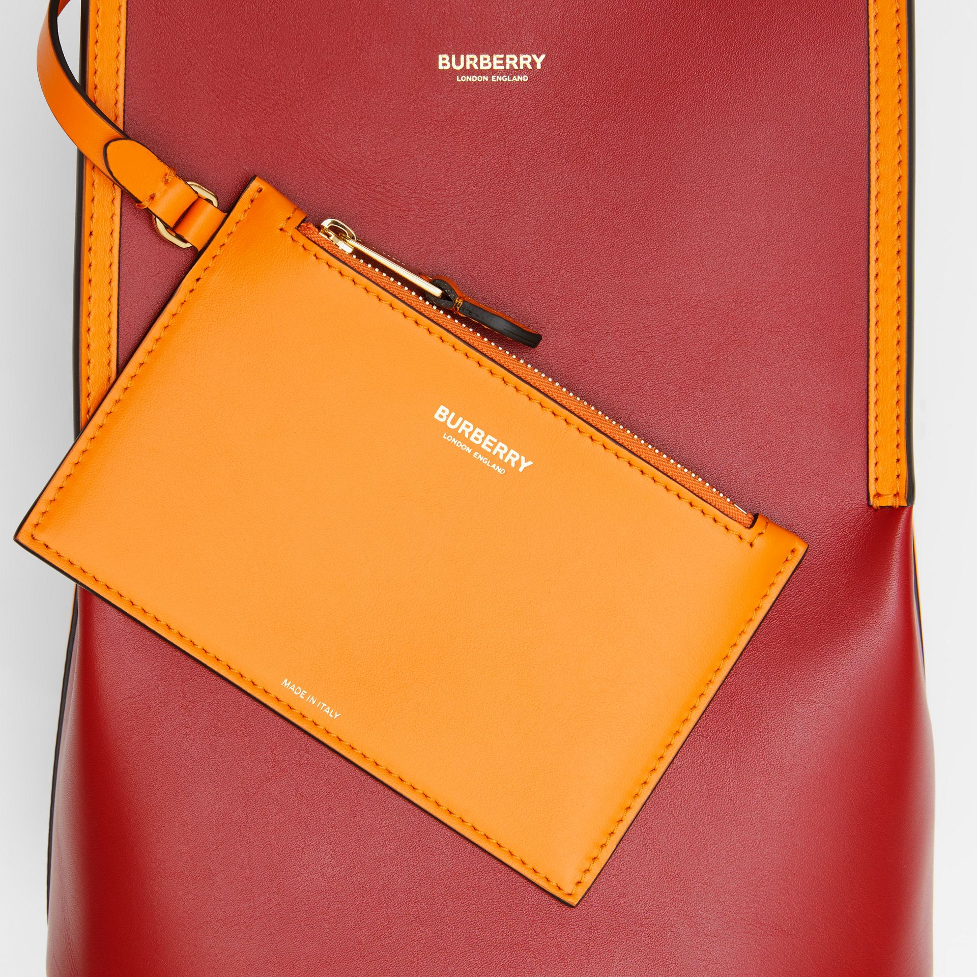 Small Two-tone Leather Peggy Bucket Bag in Crimson - Women | Burberry Australia - gallery image 1