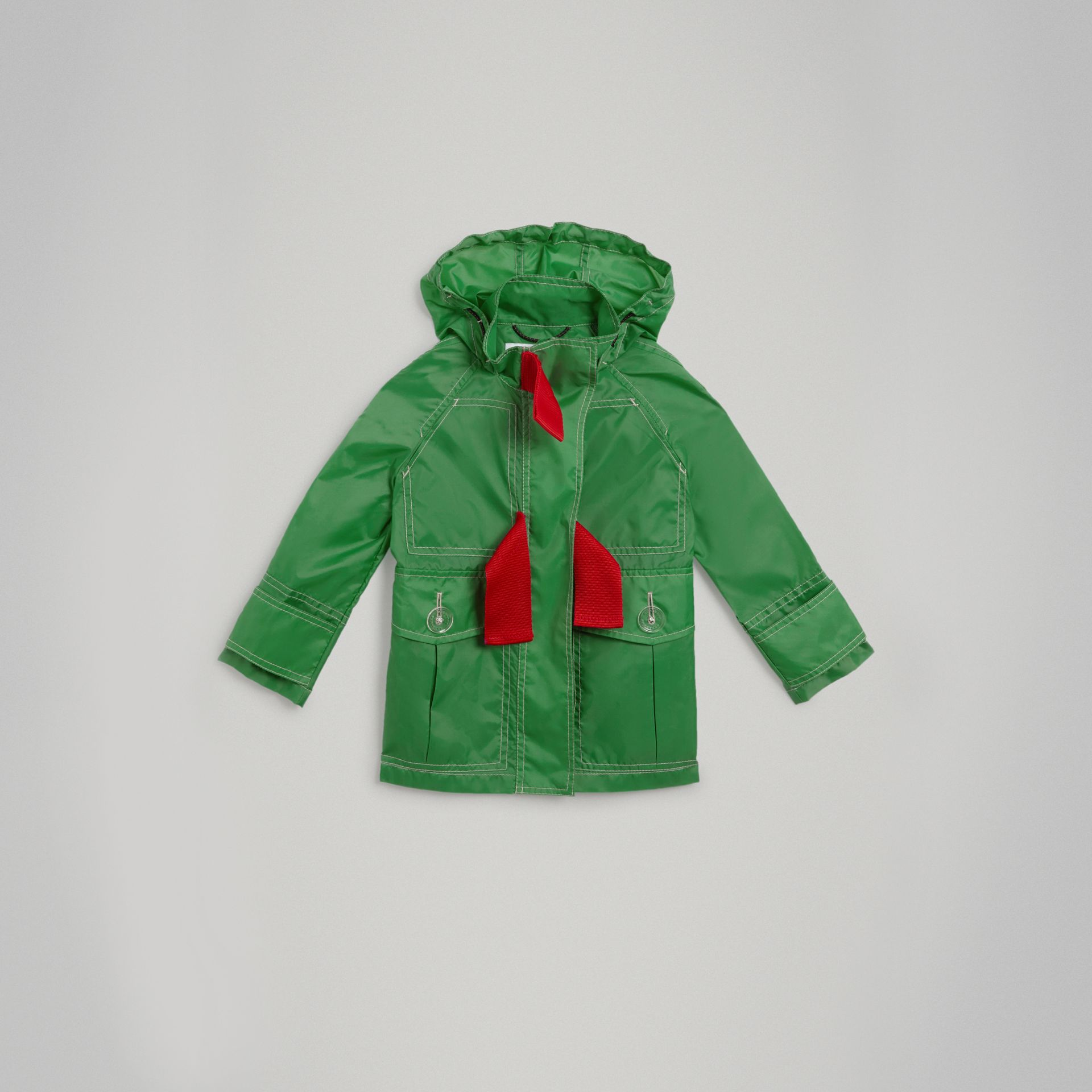 Tape Detail Rain Jacket in Bright Pigment Green - Girl | Burberry - gallery image 0