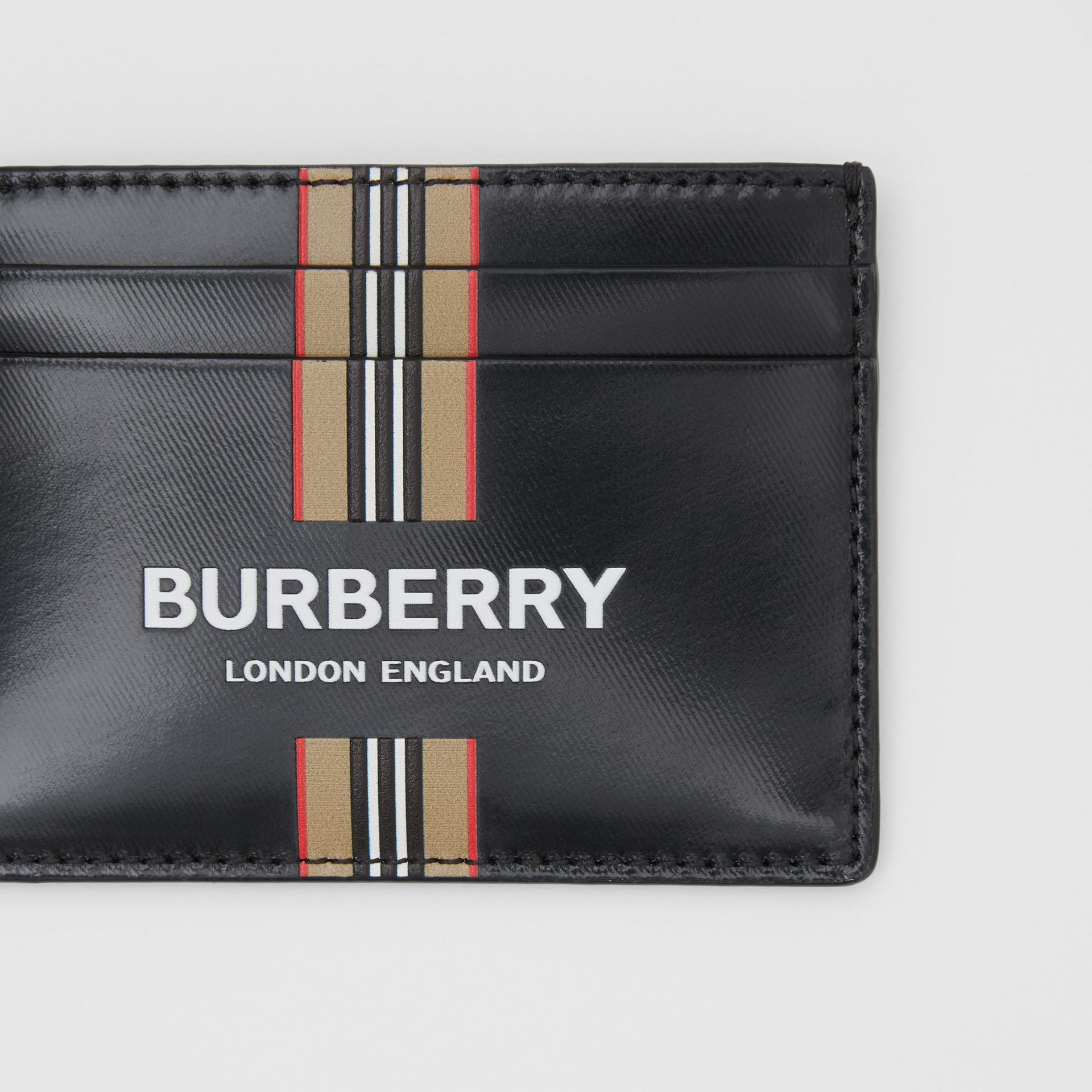 Logo and Icon Stripe Print Coated Canvas Card Case in Black | Burberry United Kingdom - gallery image 1