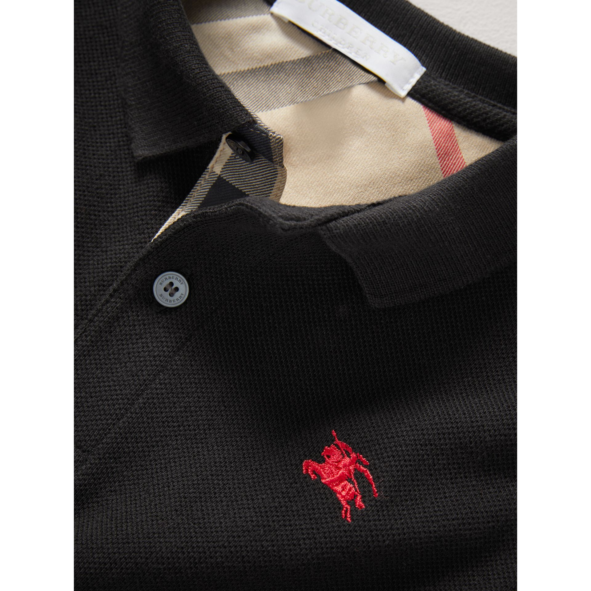 Check Placket Polo Shirt in Black - Boy | Burberry Hong Kong - gallery image 1