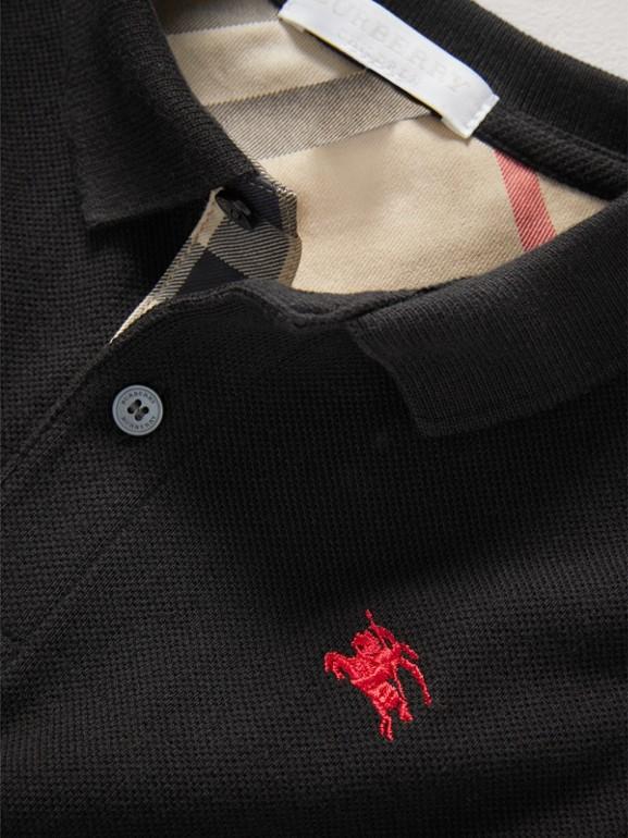 Polo con tira de botones a checks (Negro) - Niño | Burberry - cell image 1