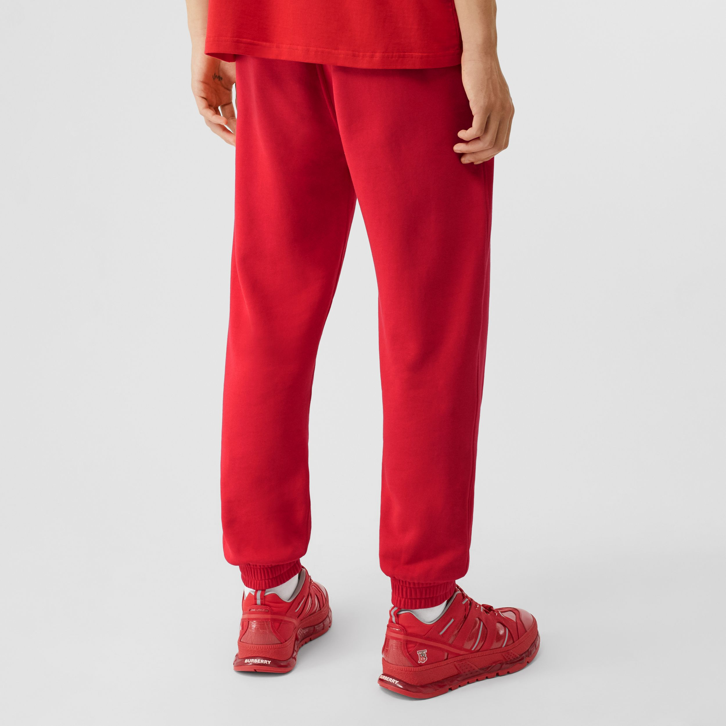 Monogram Motif Cotton Jogging Pants in Bright Red - Men | Burberry - 3