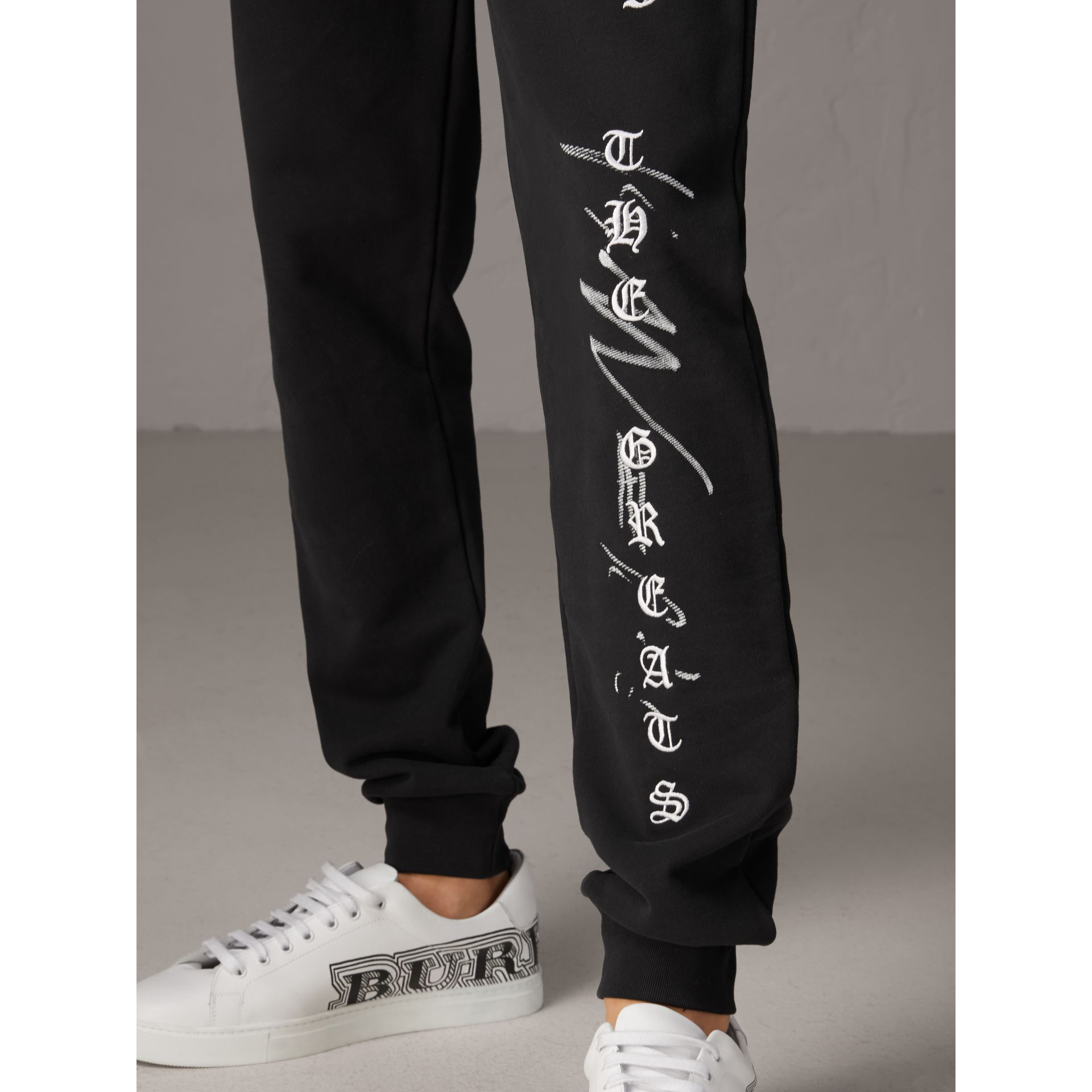 Burberry x Kris Wu Graphic Motif Sweatpants in Black - Men | Burberry - gallery image 1