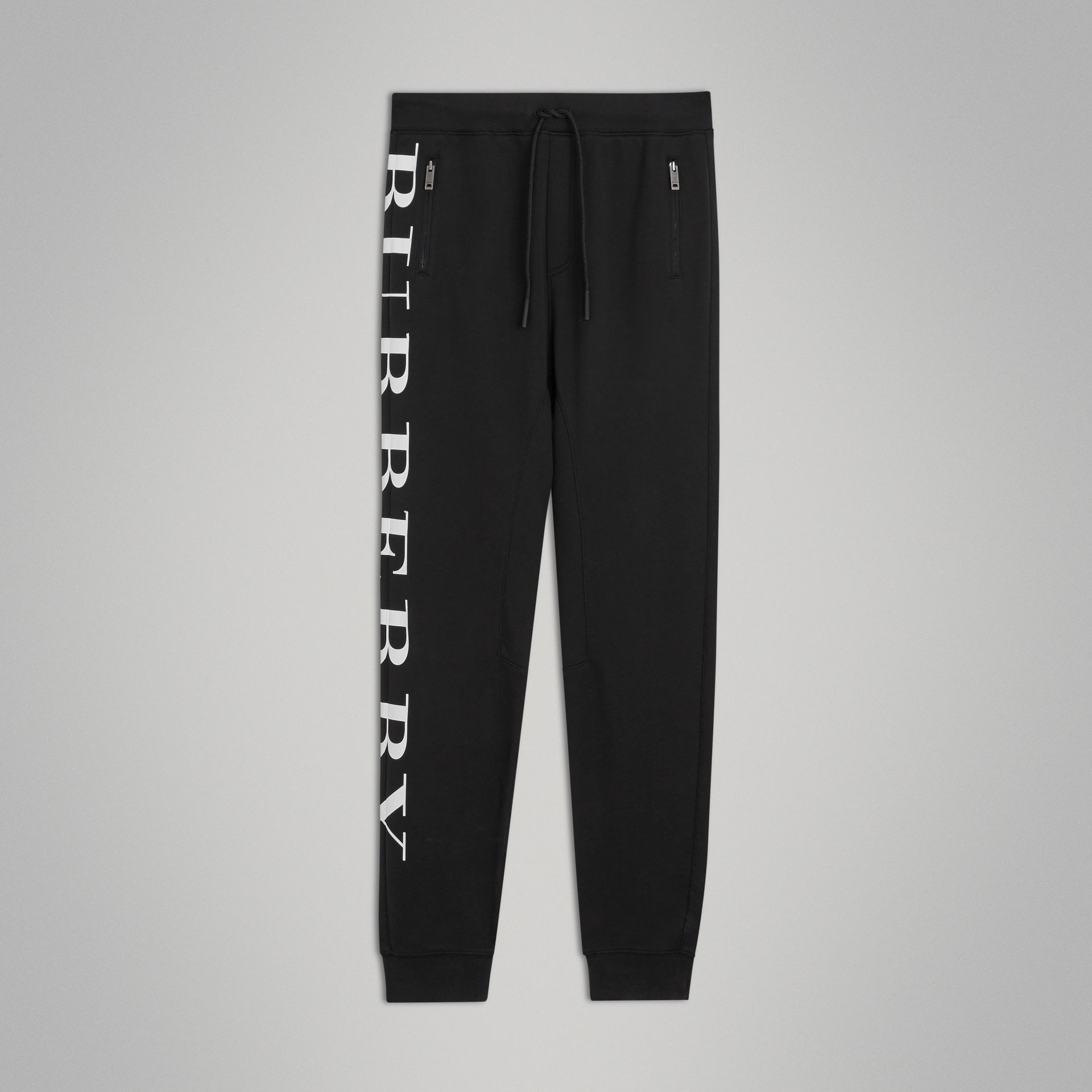 Logo Print Cotton Trackpants in Black | Burberry - gallery image 0