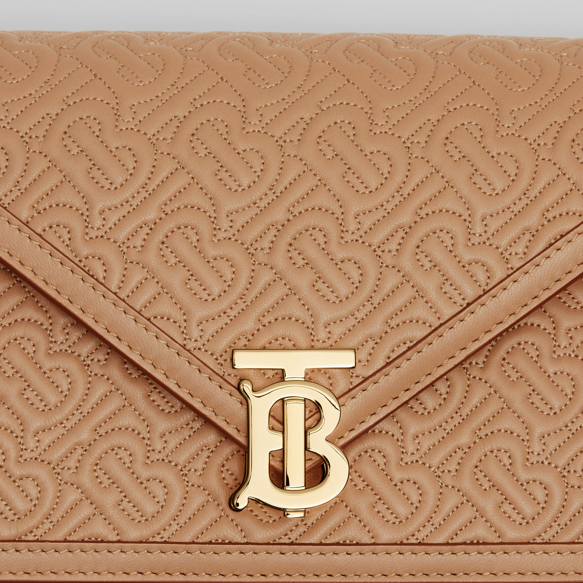 Small Quilted Monogram TB Envelope Clutch in Honey - Women | Burberry United Kingdom - gallery image 1