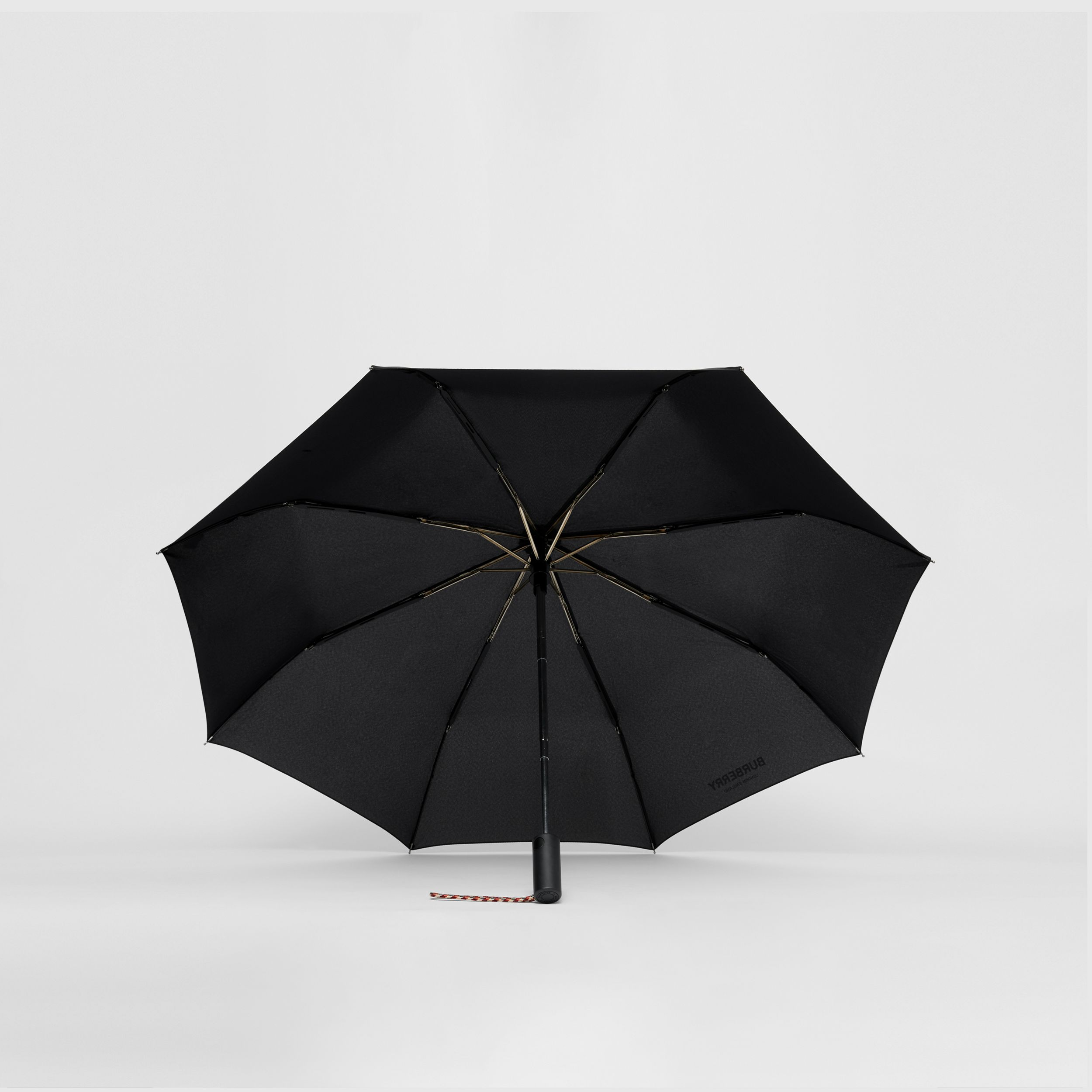 Logo Print Folding Umbrella in Archive Beige | Burberry Australia - 3