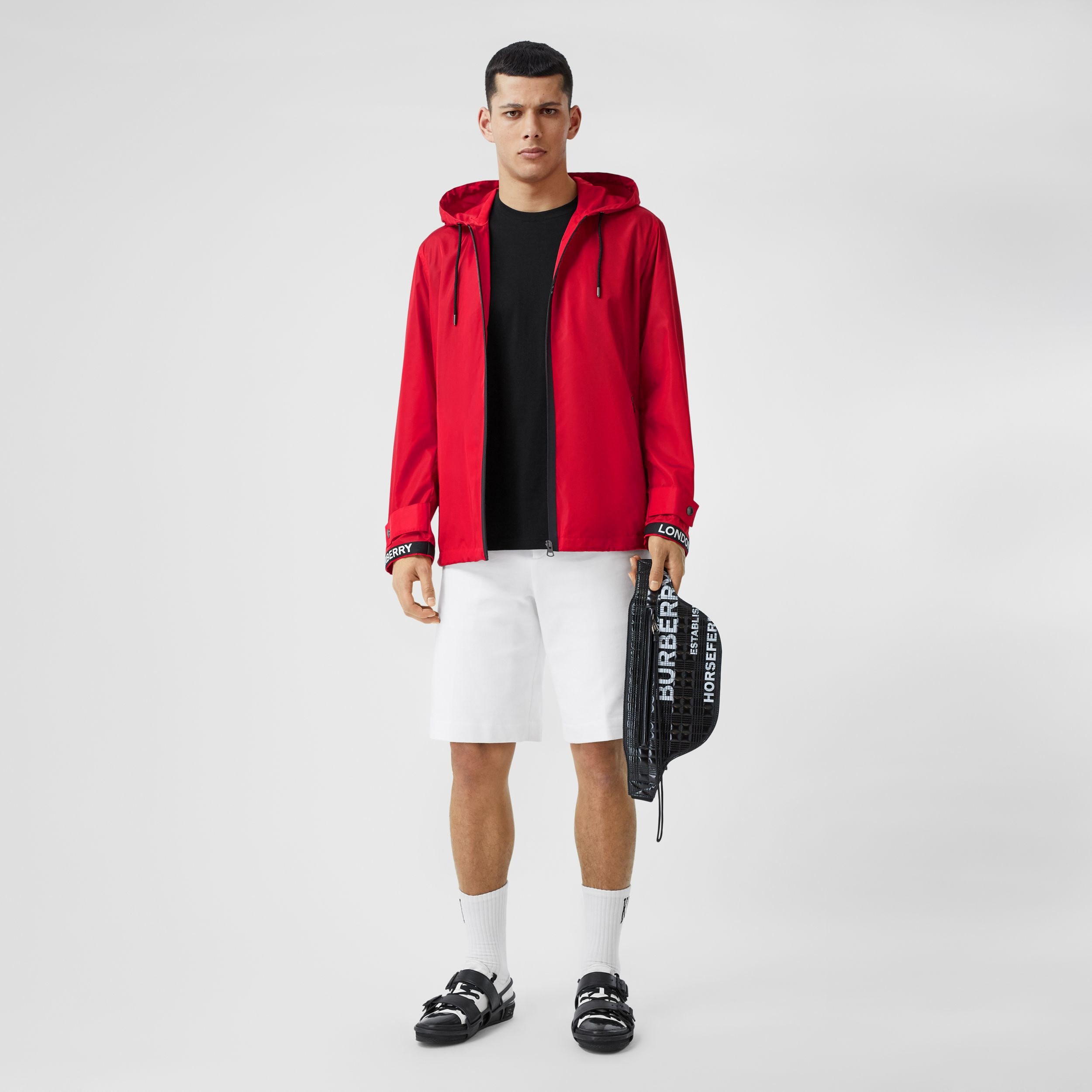 Logo Tape ECONYL® Hooded Jacket in Bright Red - Men | Burberry - 1