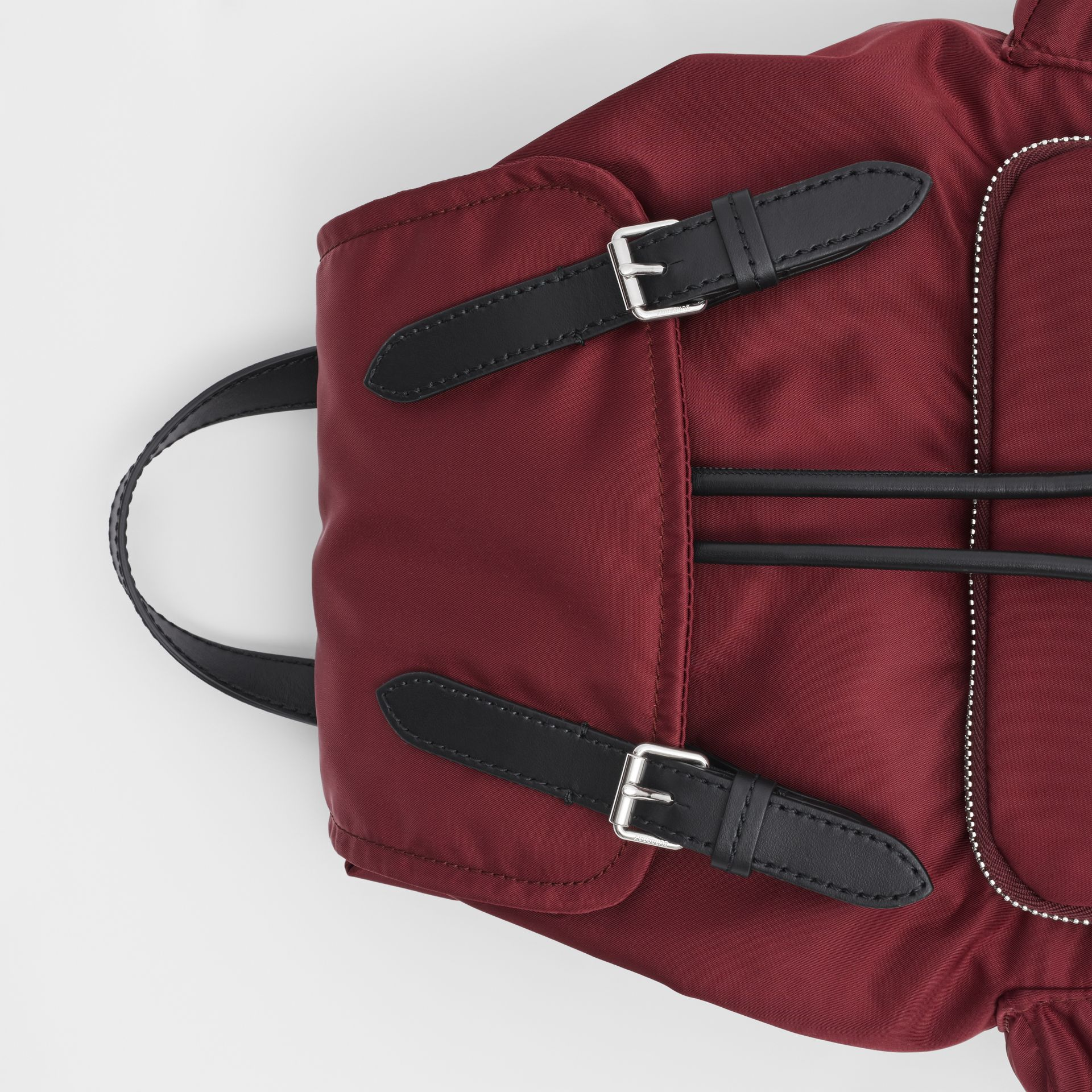 The Medium Rucksack in Logo Print ECONYL® in Burgundy - Women | Burberry - gallery image 1