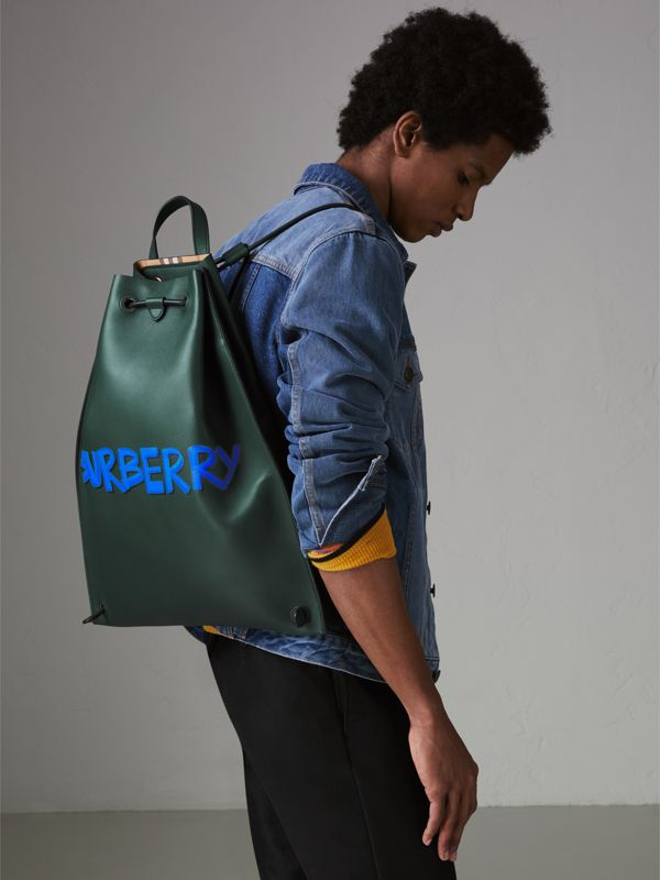 Graffiti Print Bonded Leather Drawcord Backpack in Deep Bottle Green - Men | Burberry United Kingdom - cell image 3