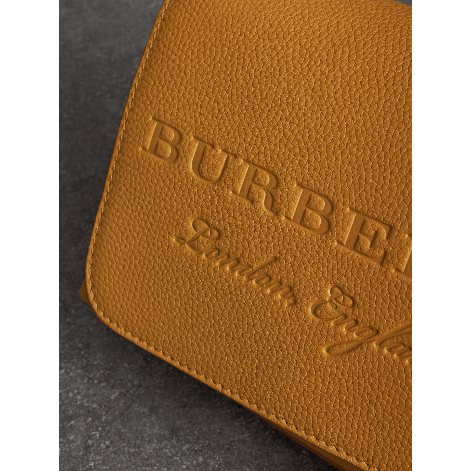 Small Embossed Leather Messenger Bag in Ochre Yellow - Women | Burberry Australia - gallery image 1