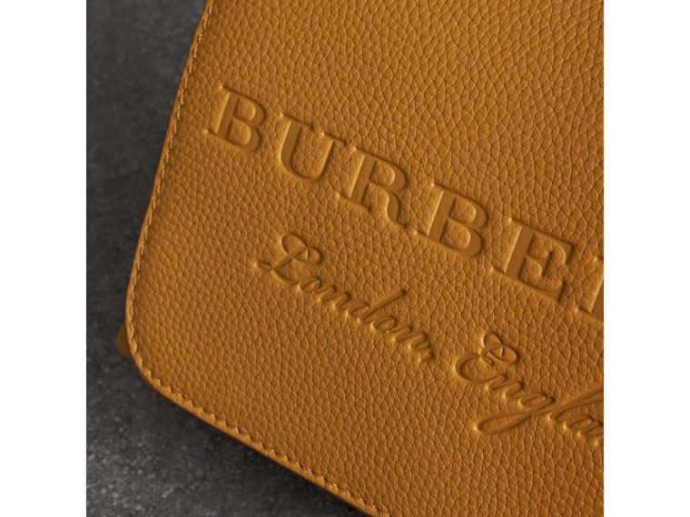 Small Embossed Leather Messenger Bag in Ochre Yellow - Women | Burberry Australia - cell image 1