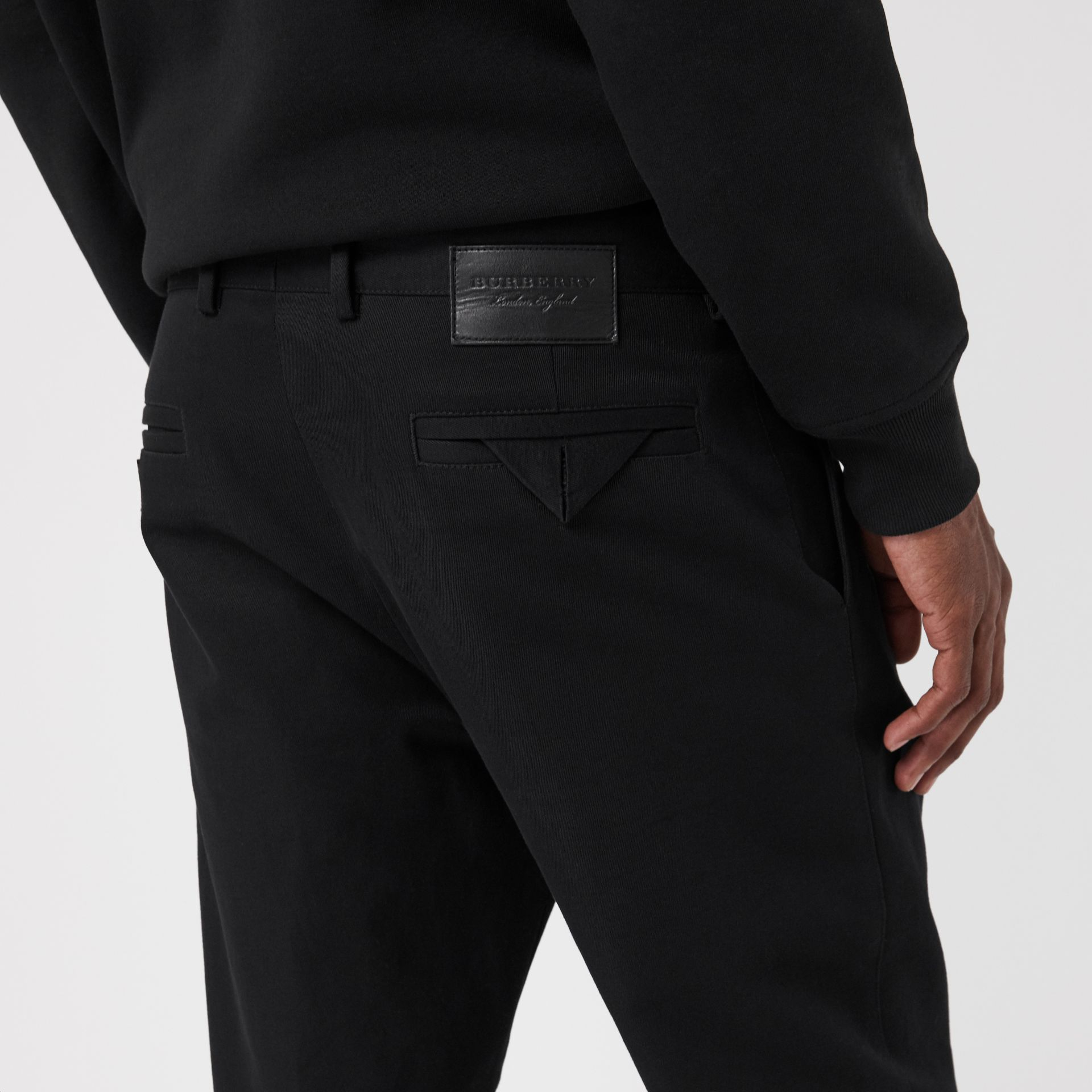 Slim Fit Cotton Blend Chinos in Black - Men | Burberry - gallery image 1