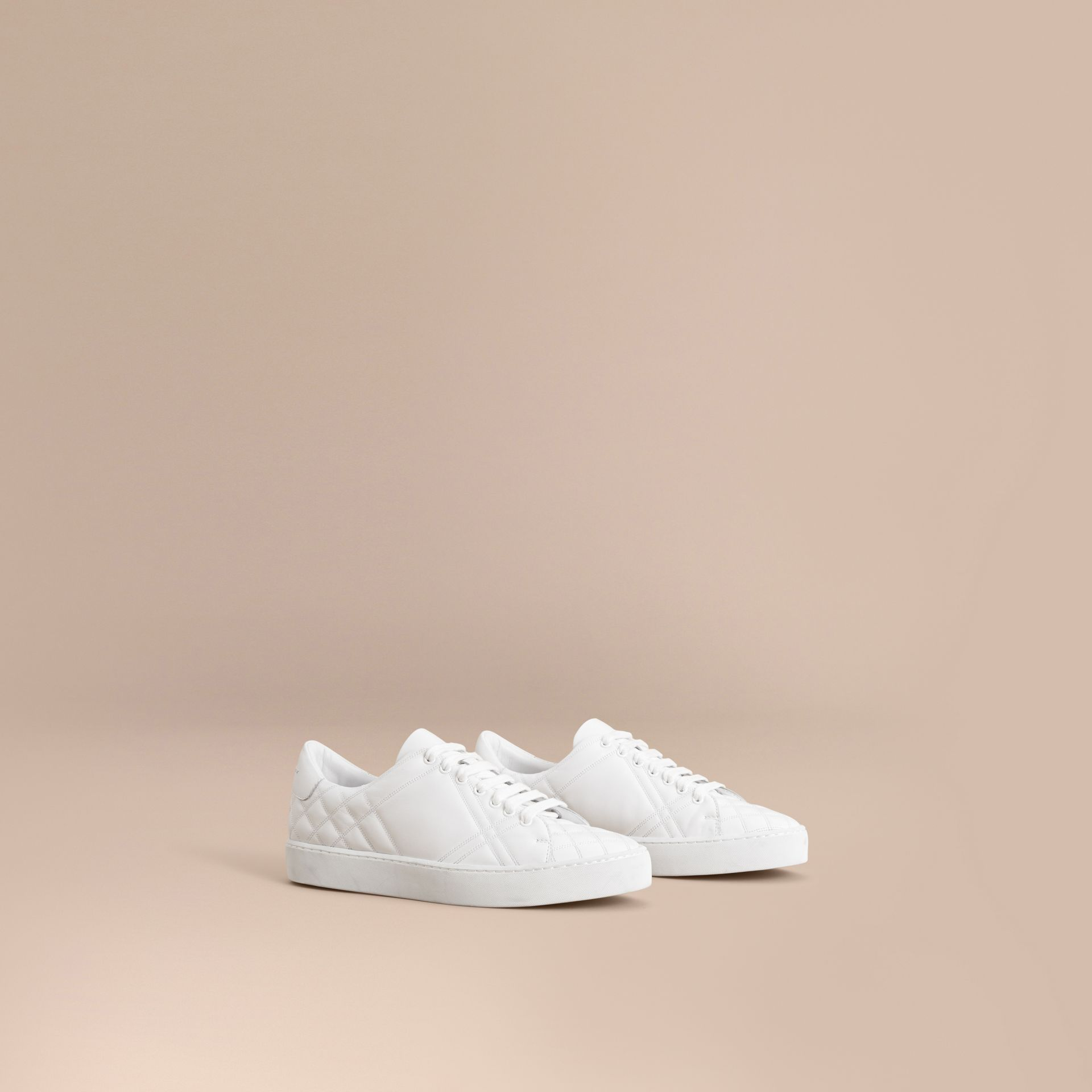Check-quilted Leather Trainers in Optic White - Women | Burberry - gallery image 1