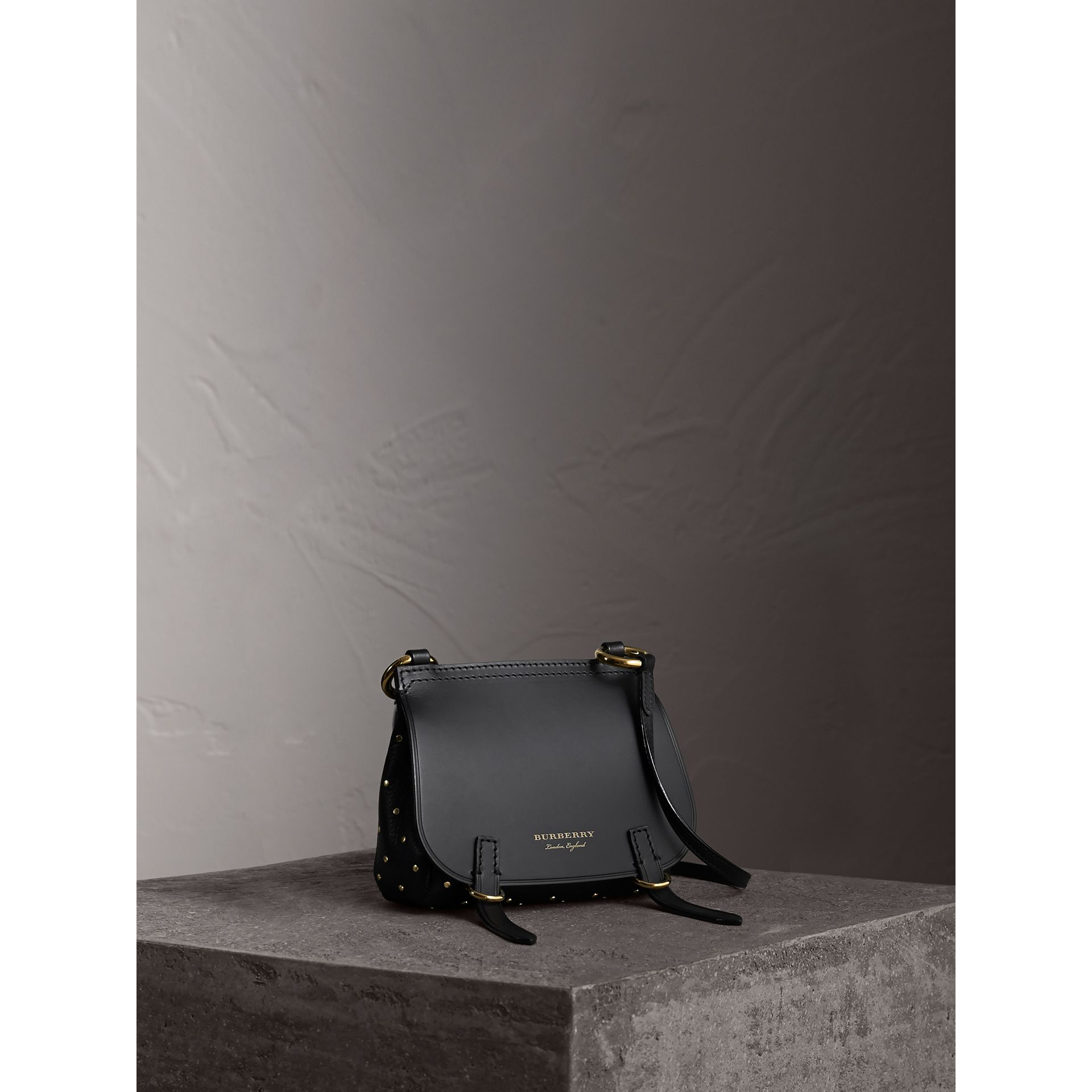 The Baby Bridle Bag in Riveted Leather in Black - Women | Burberry - gallery image 1