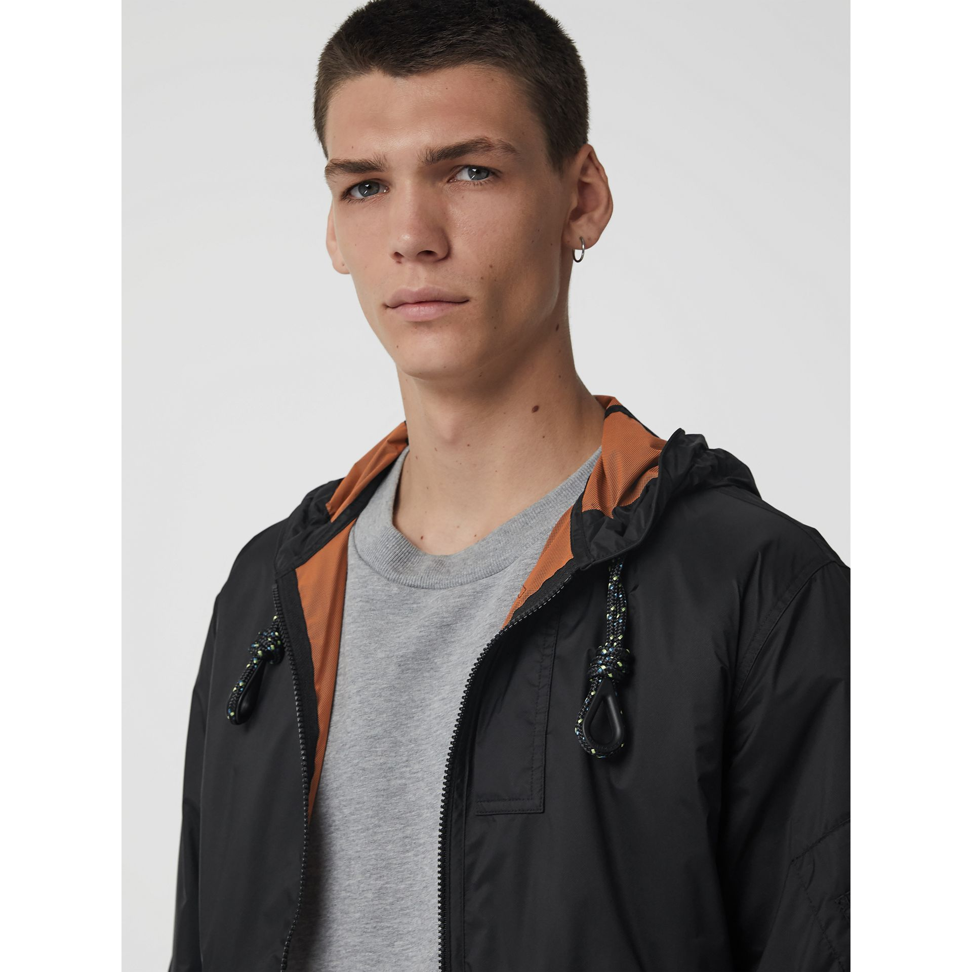 Flyweight Nylon Hooded Bomber Jacket in Black - Men | Burberry United States - gallery image 1