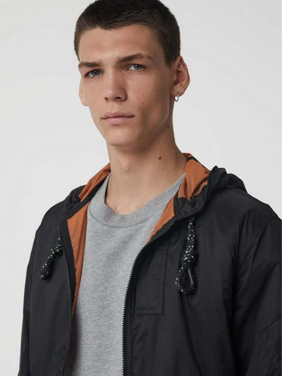 Flyweight Nylon Hooded Bomber Jacket in Black - Men | Burberry United States - cell image 1