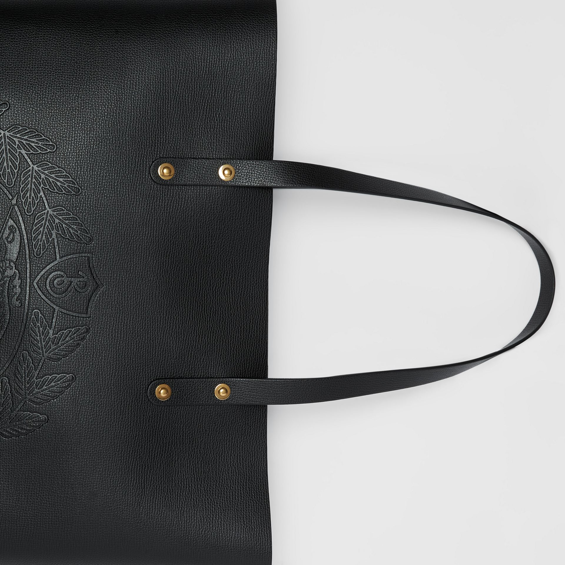 Embossed Crest Leather Tote in Black | Burberry - gallery image 1