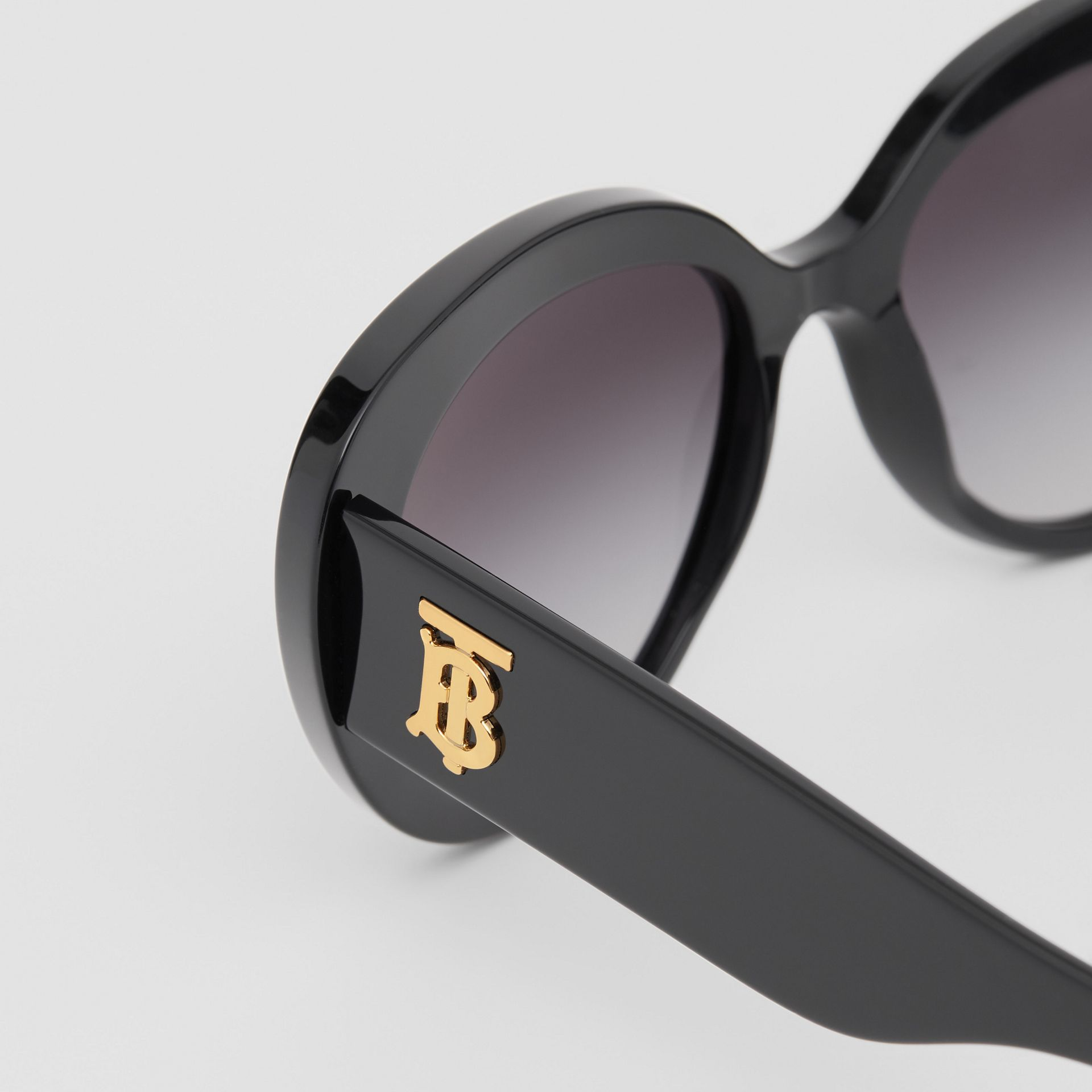 Monogram Motif Cat-eye Frame Sunglasses in Black - Women | Burberry United Kingdom - gallery image 1