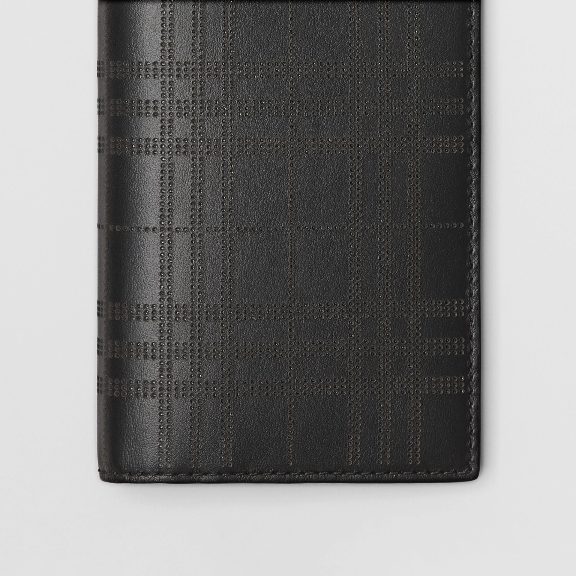 Perforated Check Leather Continental Wallet in Black - Men | Burberry - gallery image 1