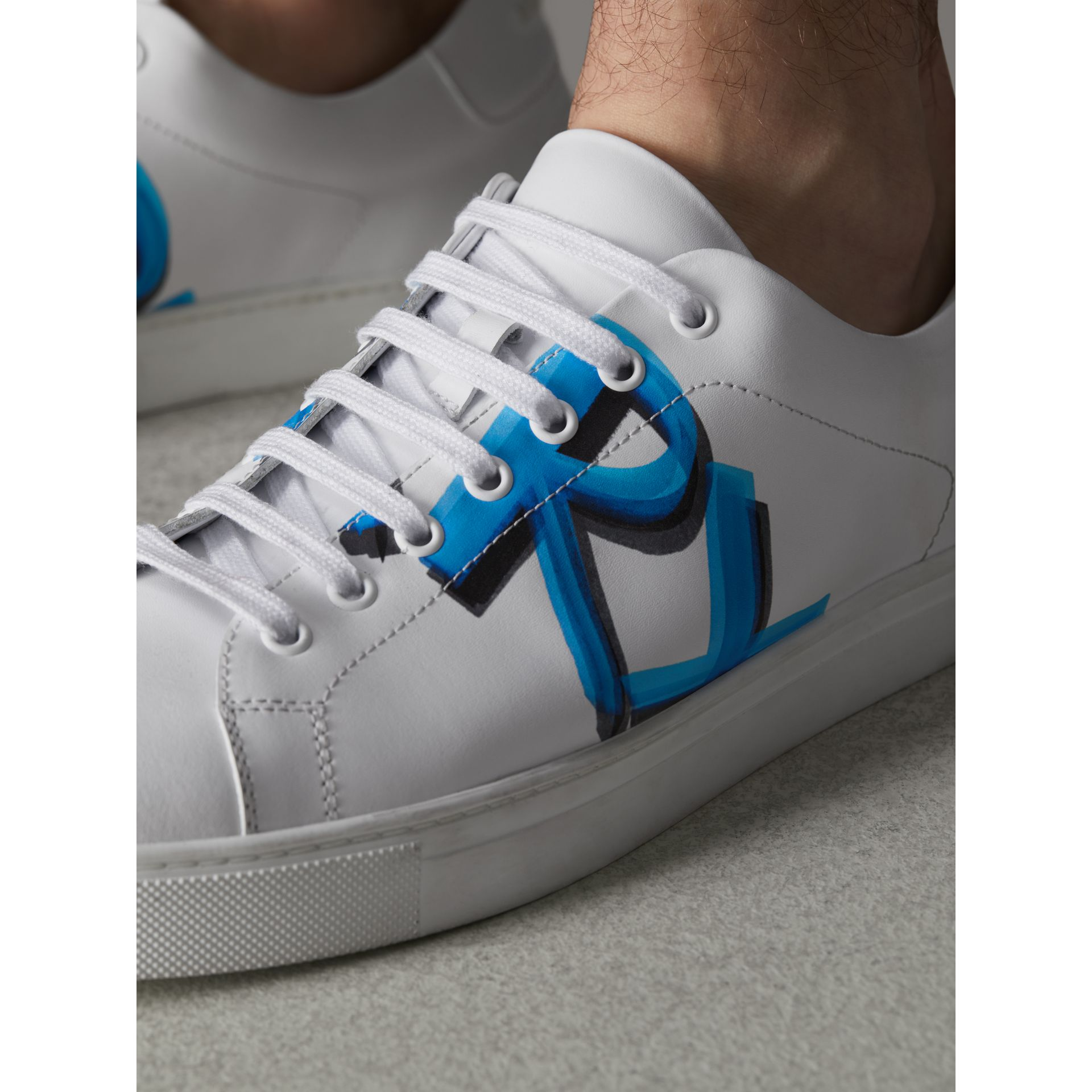 Logo Print Leather Sneakers in Optic White/bright Sky Blue - Men | Burberry - gallery image 3