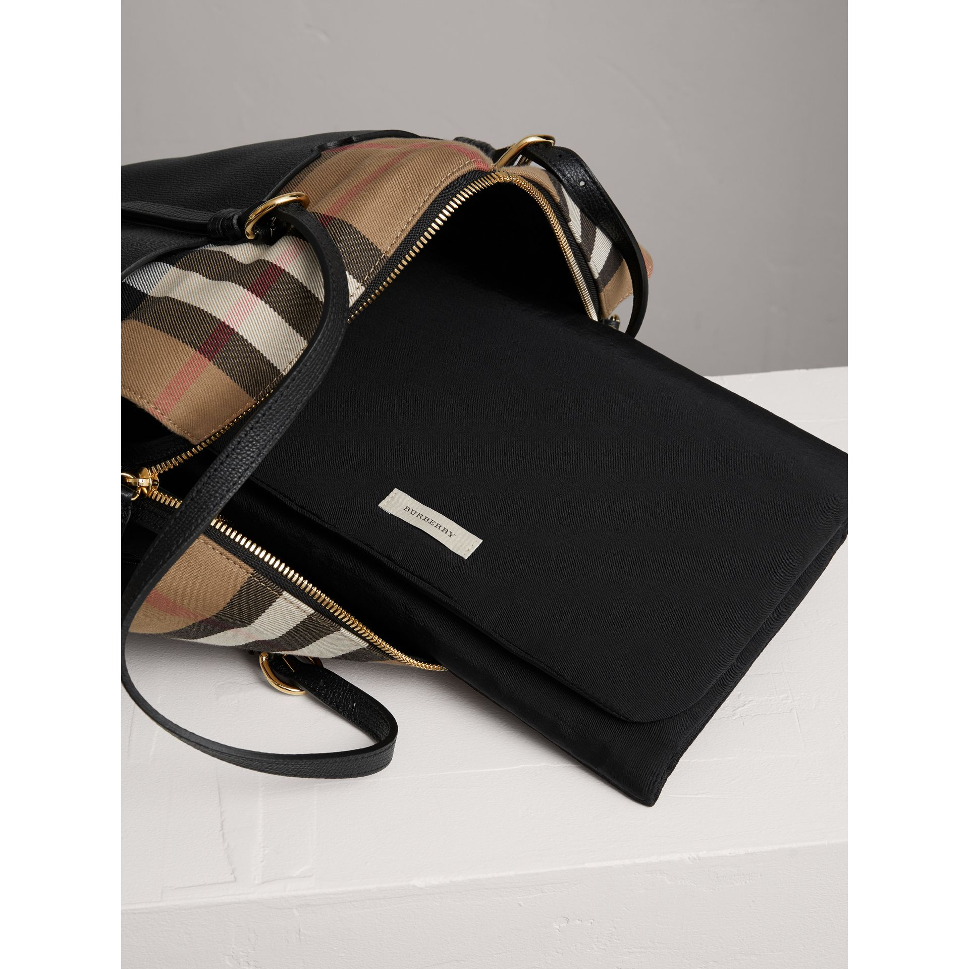 House Check and Leather Baby Changing Bag in Black | Burberry United States - gallery image 1