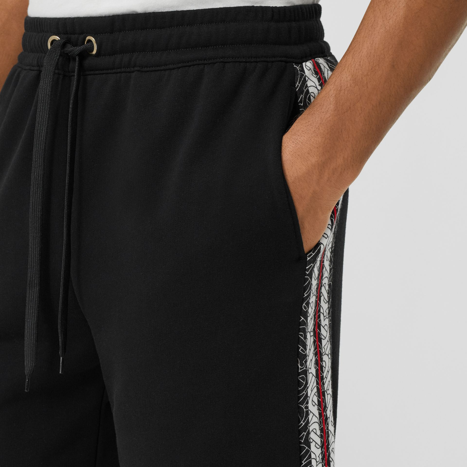 Monogram Stripe Print Cotton Shorts in Black - Men | Burberry - gallery image 1
