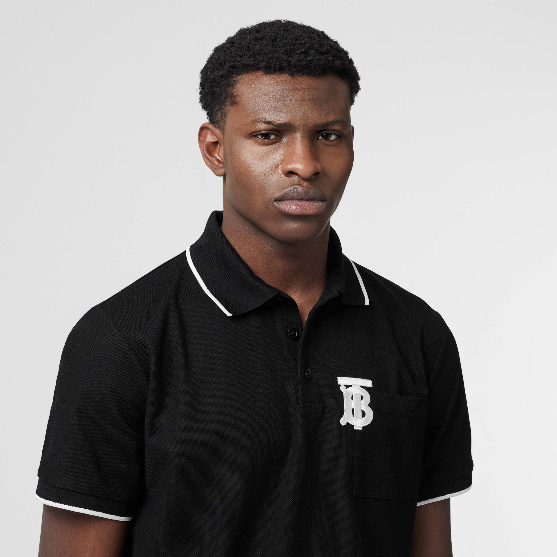 Monogram Motif Tipped Cotton Piqué Polo Shirt in Black - Men | Burberry United Kingdom - gallery image 1