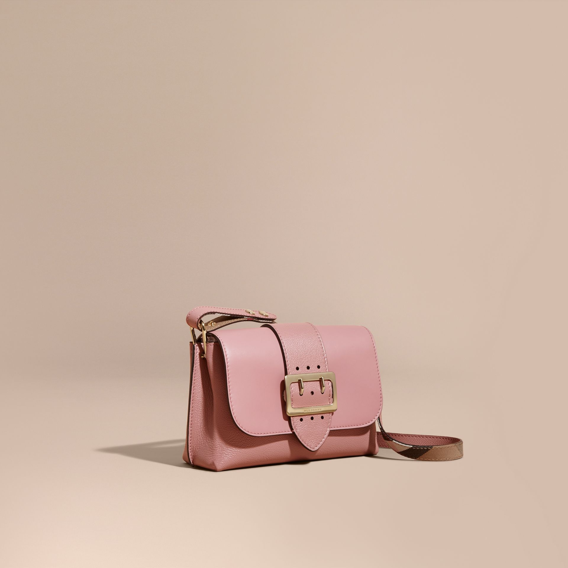 The Buckle Crossbody Bag in Leather in Dusty Pink - gallery image 1