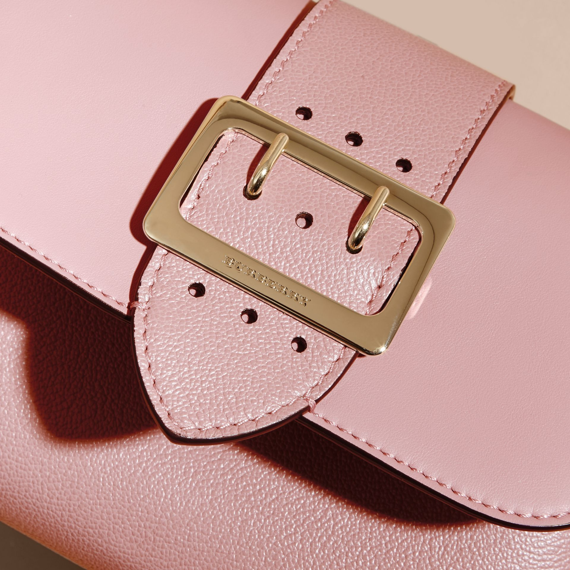 The Buckle Crossbody Bag in Leather in Dusty Pink - gallery image 2