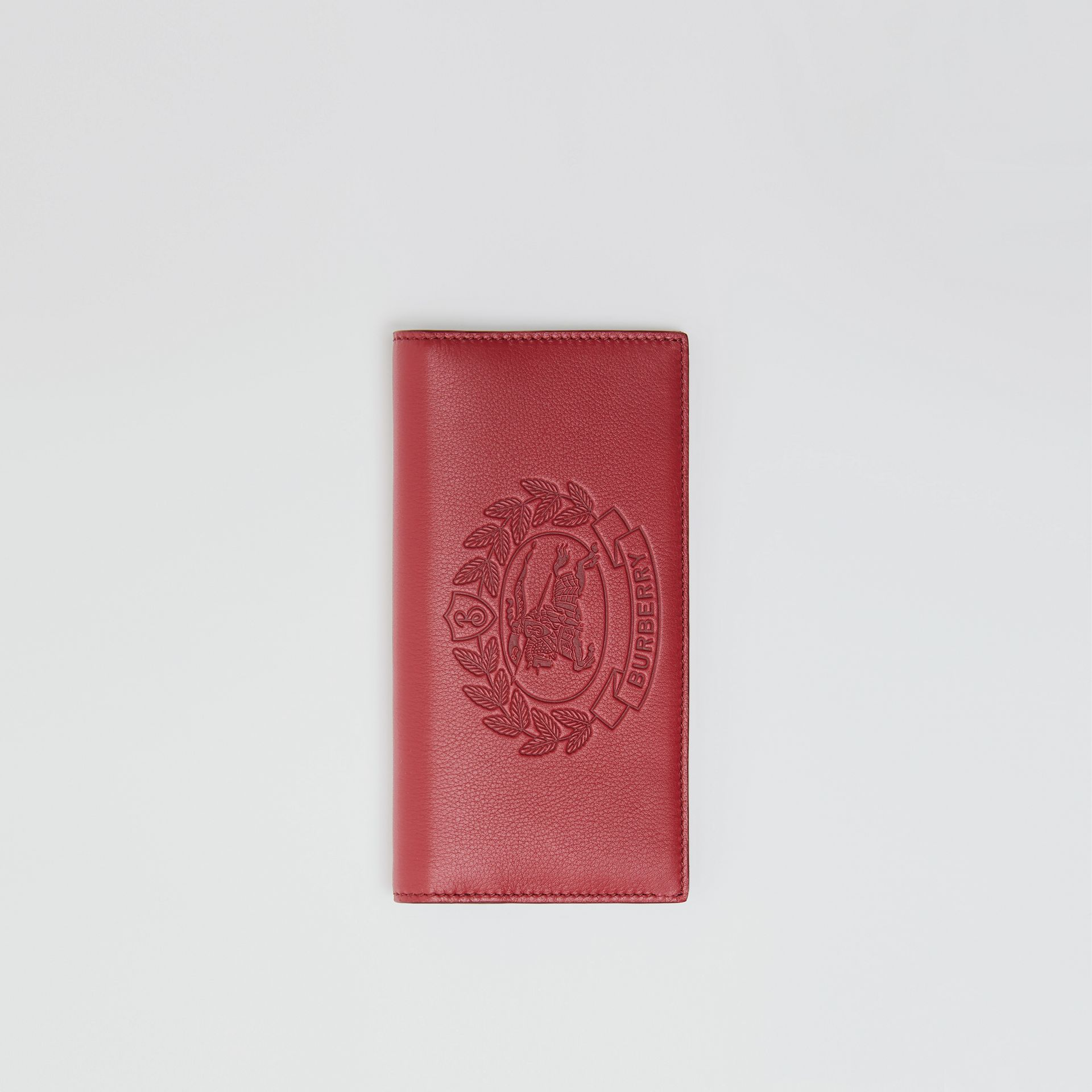 Embossed Crest Leather Continental Wallet in Crimson - Men | Burberry - gallery image 0