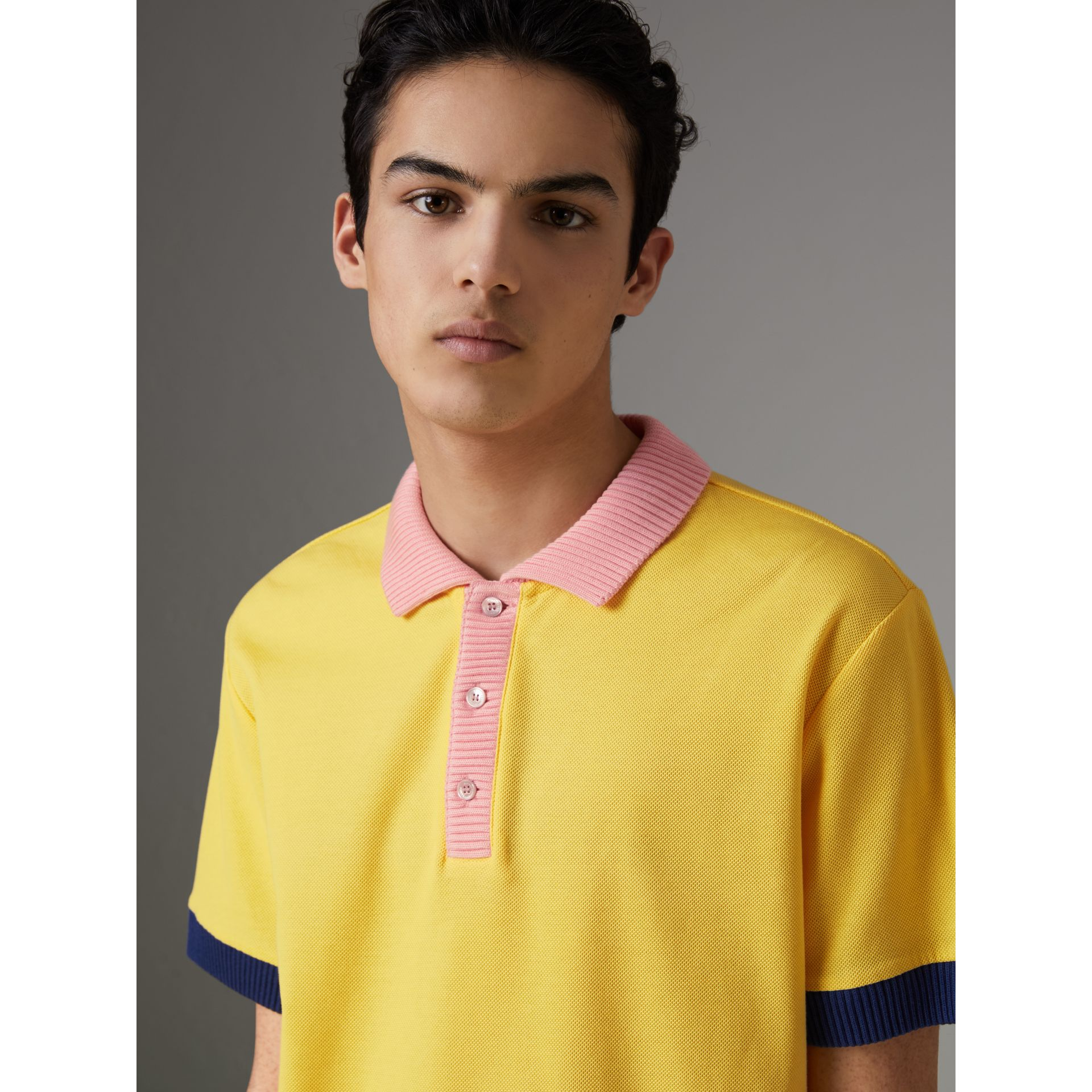 Two-tone Stripe Knitted Detail Cotton Polo Shirt in Saffron Yellow - Men | Burberry United States - gallery image 1