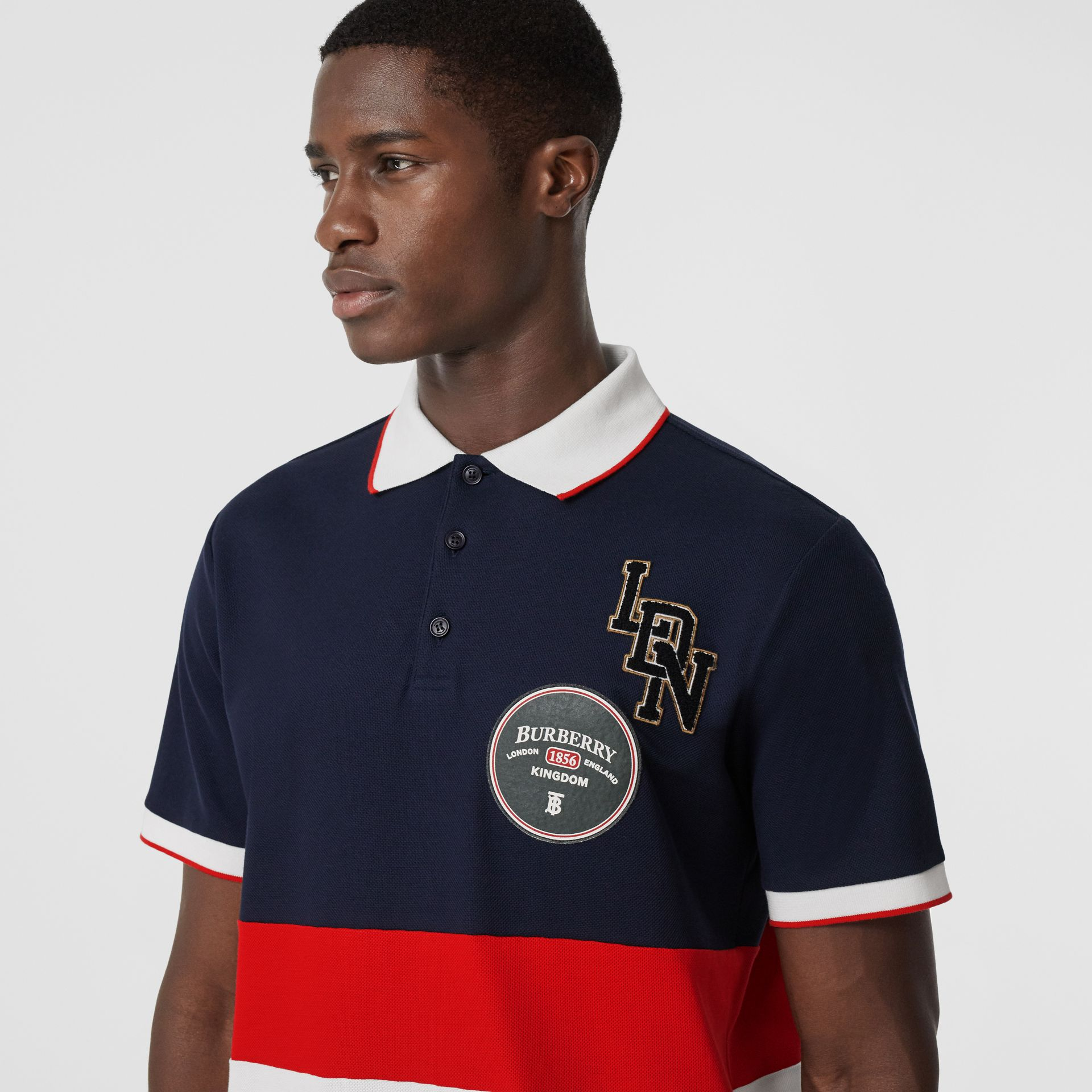 Logo Graphic Cotton Piqué Polo Shirt in Navy - Men | Burberry United Kingdom - gallery image 1