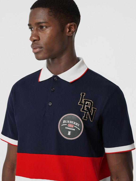 Logo Graphic Cotton Piqué Polo Shirt in Navy - Men | Burberry United Kingdom - cell image 1