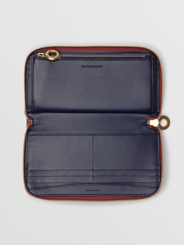 Embossed Crest Two-tone Leather Ziparound Wallet in Crimson - Women | Burberry Canada - cell image 2