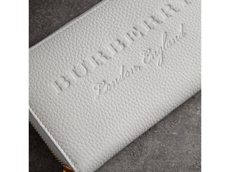 Embossed Leather Ziparound Wallet in Chalk White - Women | Burberry Australia - cell image 1