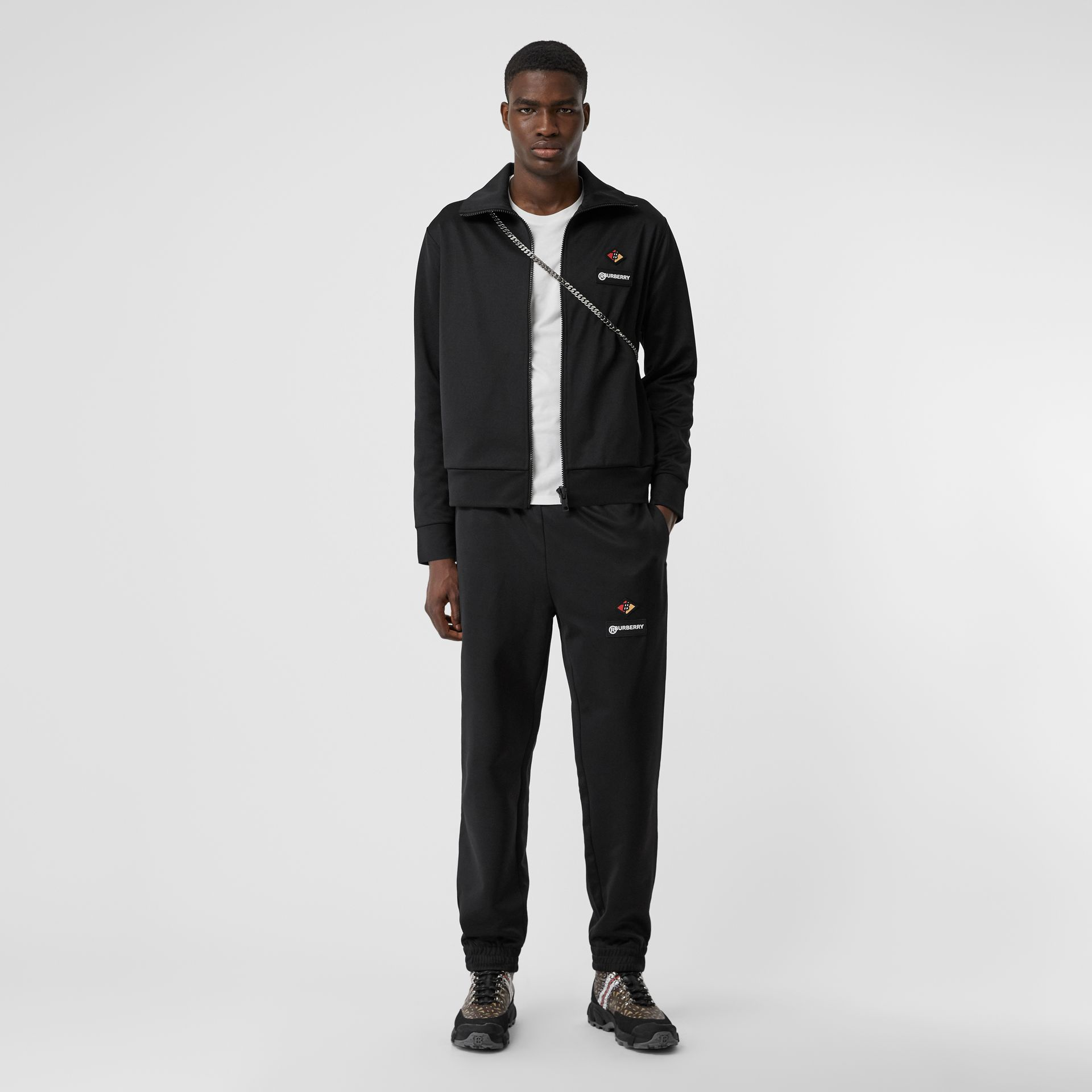 Logo Graphic Jersey Trackpants in Black - Men | Burberry - gallery image 0